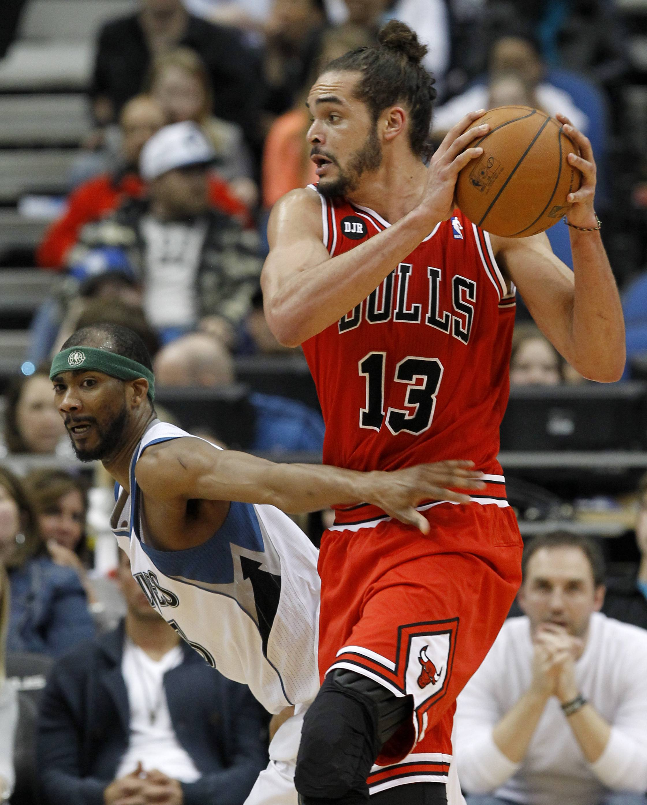 Chicago Bulls center Joakim Noah (13) wrestles the ball away from Minnesota Timberwolves forward Corey Brewer during the fourth quarter of an NBA basketball game in Minneapolis, Wednesday, April 9, 2014. The Bulls won 102-87. (AP Photo/Ann Heisenfelt)