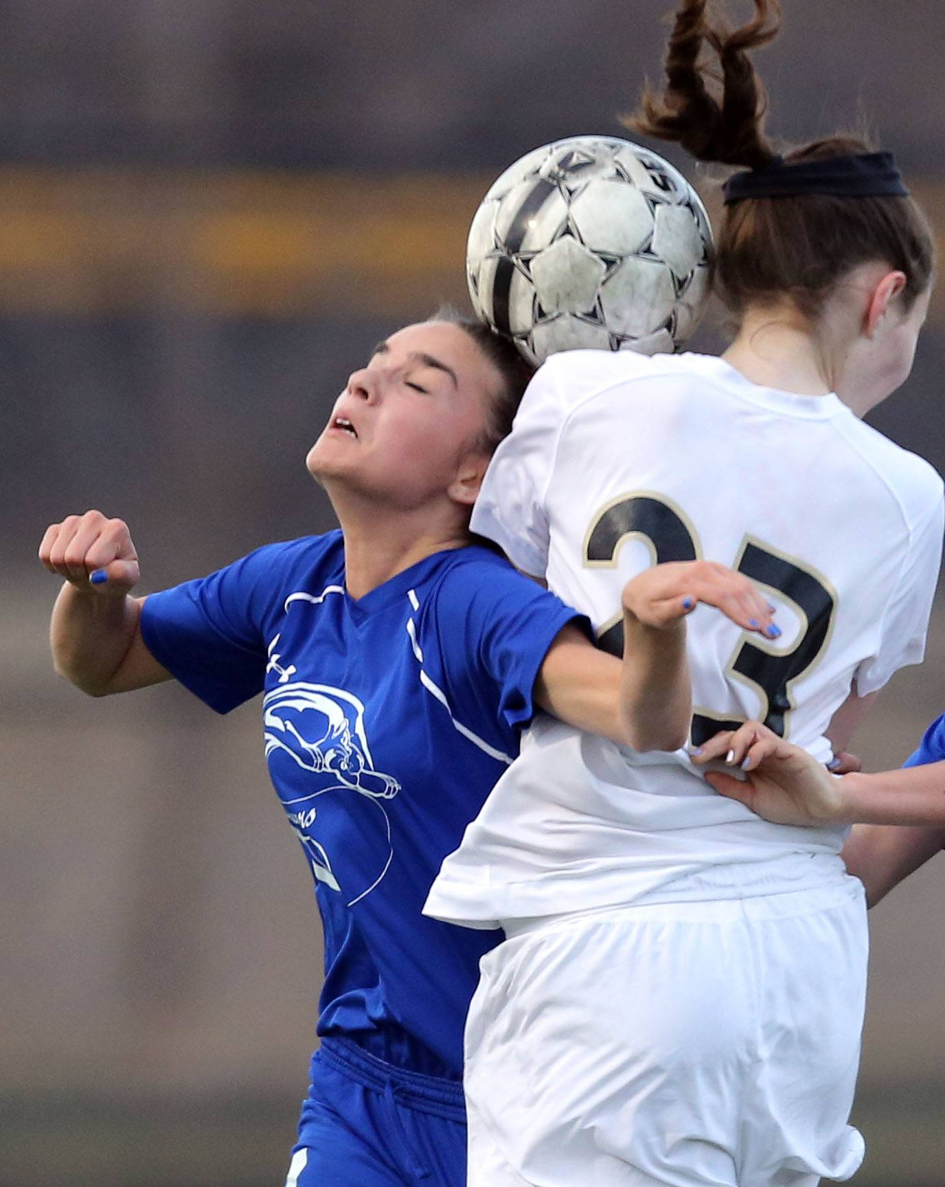Vernon Hills' Natalina Mariduena, left, and Grayslake North's Meghan McCue go up for a header Wednesday night at Grayslake North.