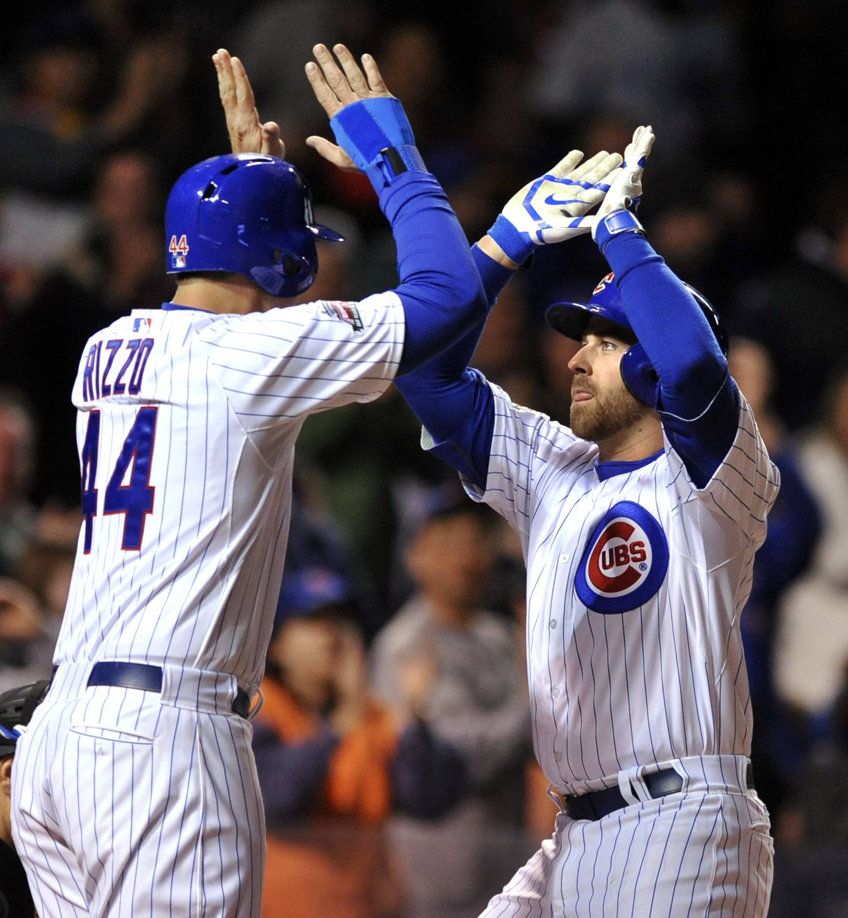 Chicago Cubs' Mike Olt right, celebrates with Anthony Rizzo at home plate after hitting a two-run home run during the fifth inning of a baseball game against the Pittsburgh Pirates in Chicago, Wednesday, April 9, 2014. (AP Photo/Paul Beaty)