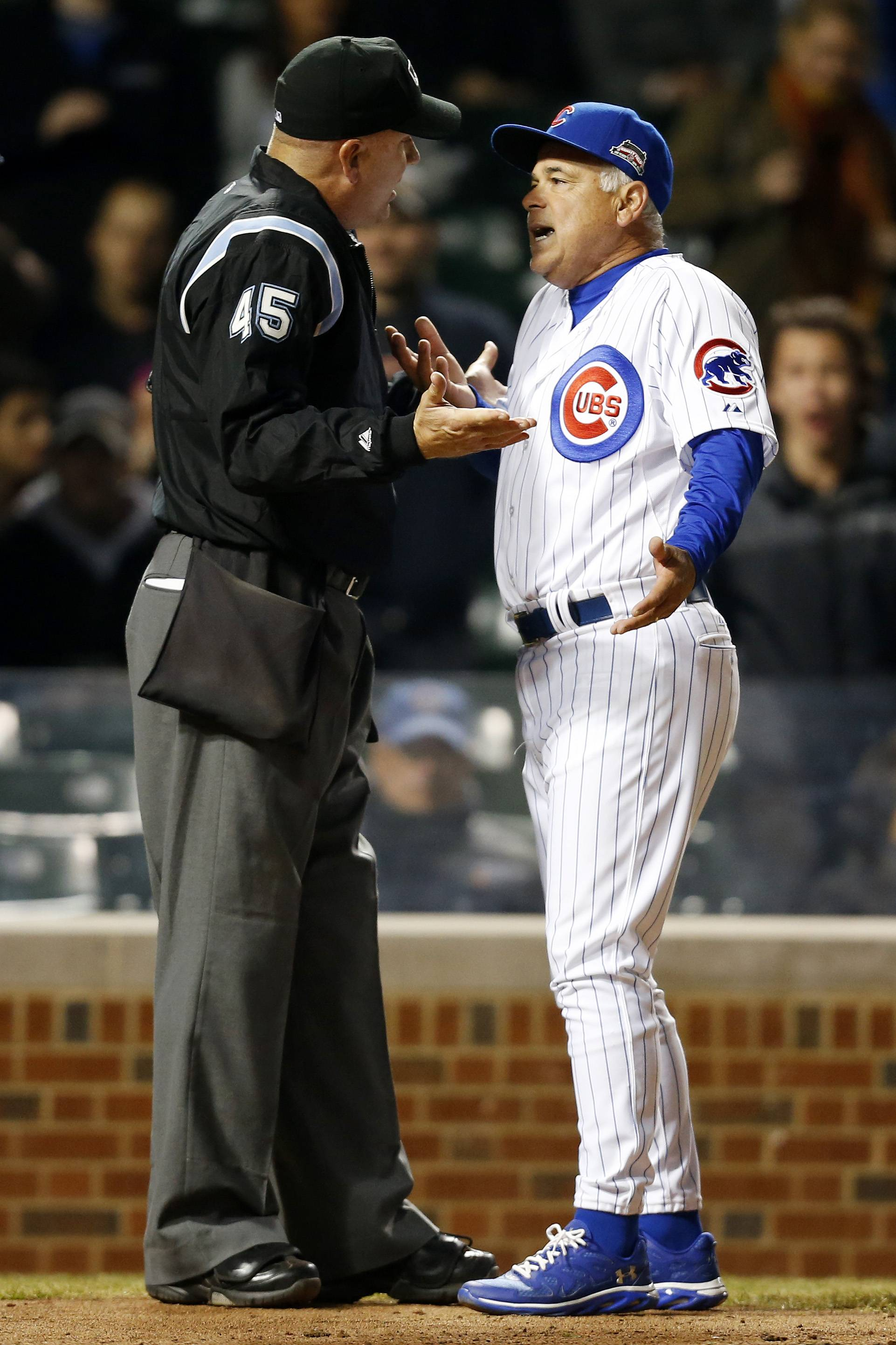 Umpire Jeff Nelson and Chicago Cubs manager Rick Renteria argue a call during the ninth inning of a baseball game against the Pittsburgh Pirates on Tuesday, April 8, 2014, in Chicago. Chicago Cubs manager Rick Renteria was ejected from the game following the argument. The Pittsburgh Pirates won 7-6. (AP Photo/Andrew A. Nelles)