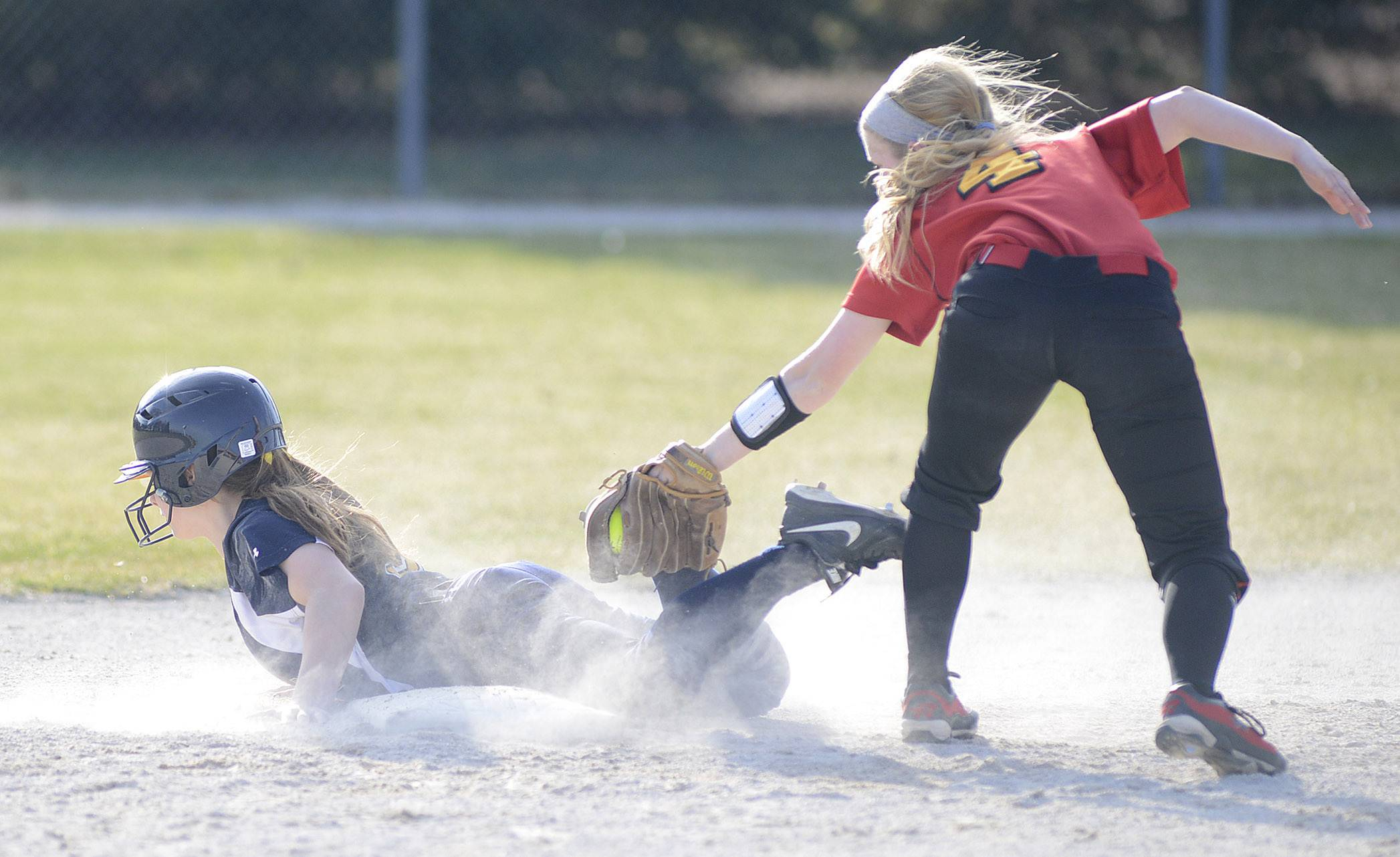 Neuqua Valley's Jenny Budds beats the tag from Batavia's Elyse Burns.