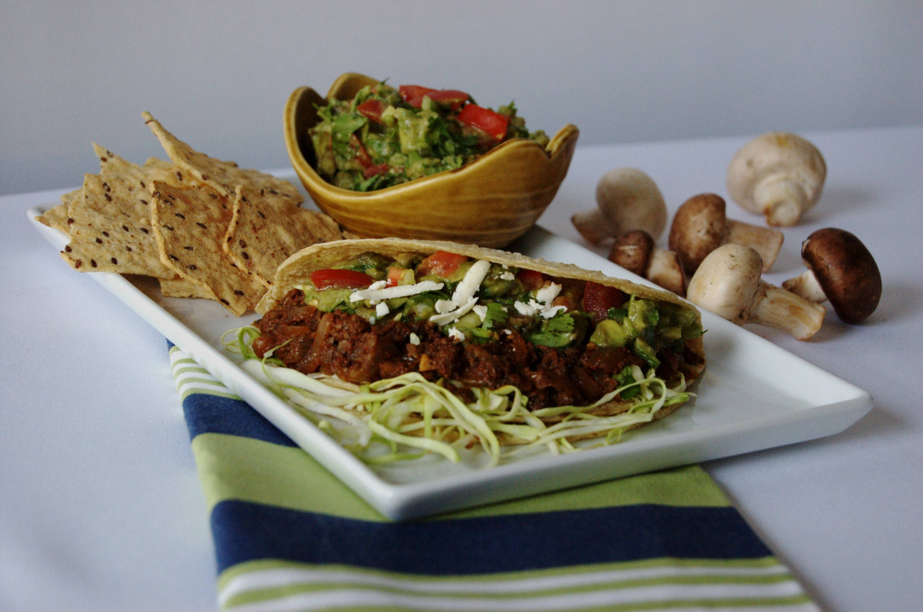 Adding chopped mushrooms to ground beef raises the nutrition profile and lowers the per-portion cost of these Mushroom Tacos with Salsa Verde.