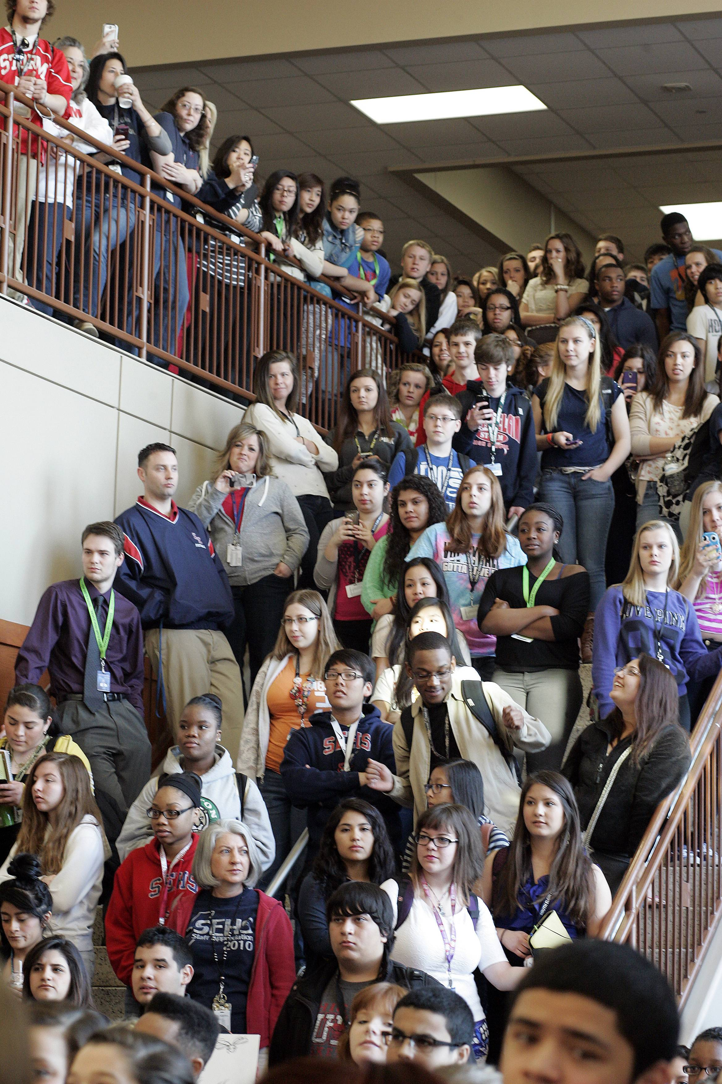 Brian Hill/bhill@dailyherald.comThousands of students line the halls of South Elgin High School to watch as the village is awarded the 101.9 FM, The Mix trophy after they won Eric and Kathy's Suburban Madness Battle of the Burbs Contest.
