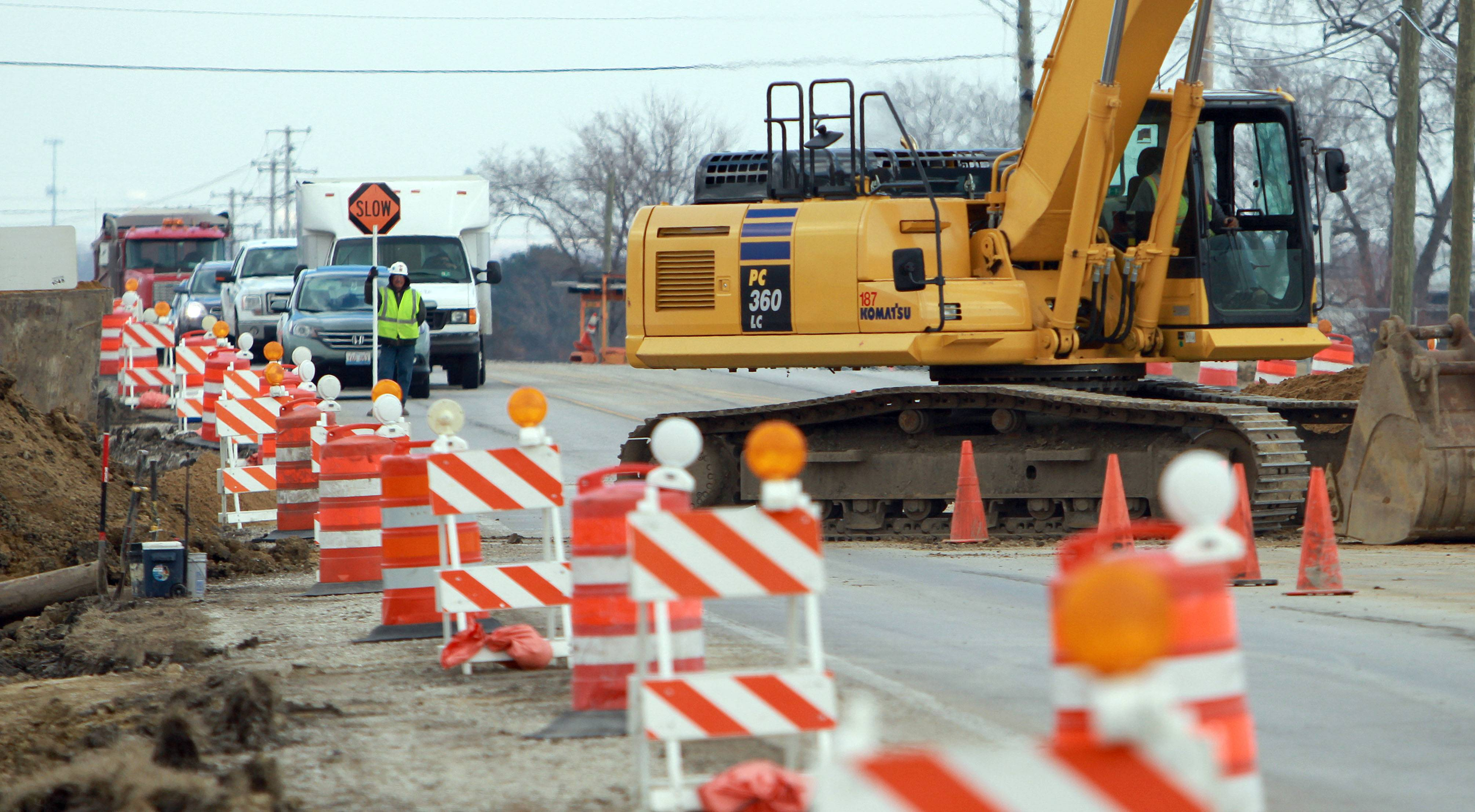 Traffic is stopped in both directions during construction on Peterson Road near Midlothian Road in Libertyville.