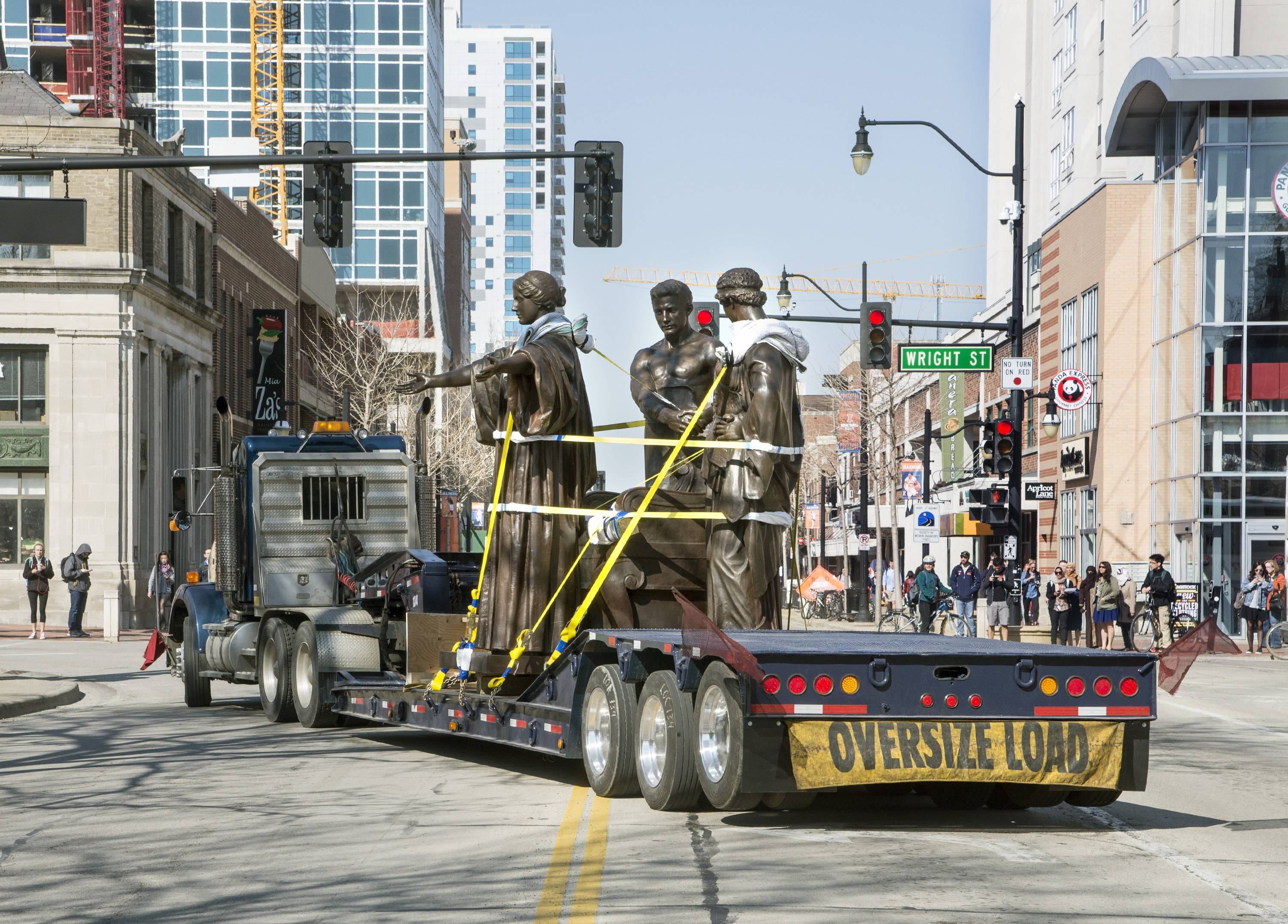 The University of Illinois' Alma Mater statue arrives on a flatbed truck to be reinstalled in front of Altgeld Hall Wednesday in Urbana.