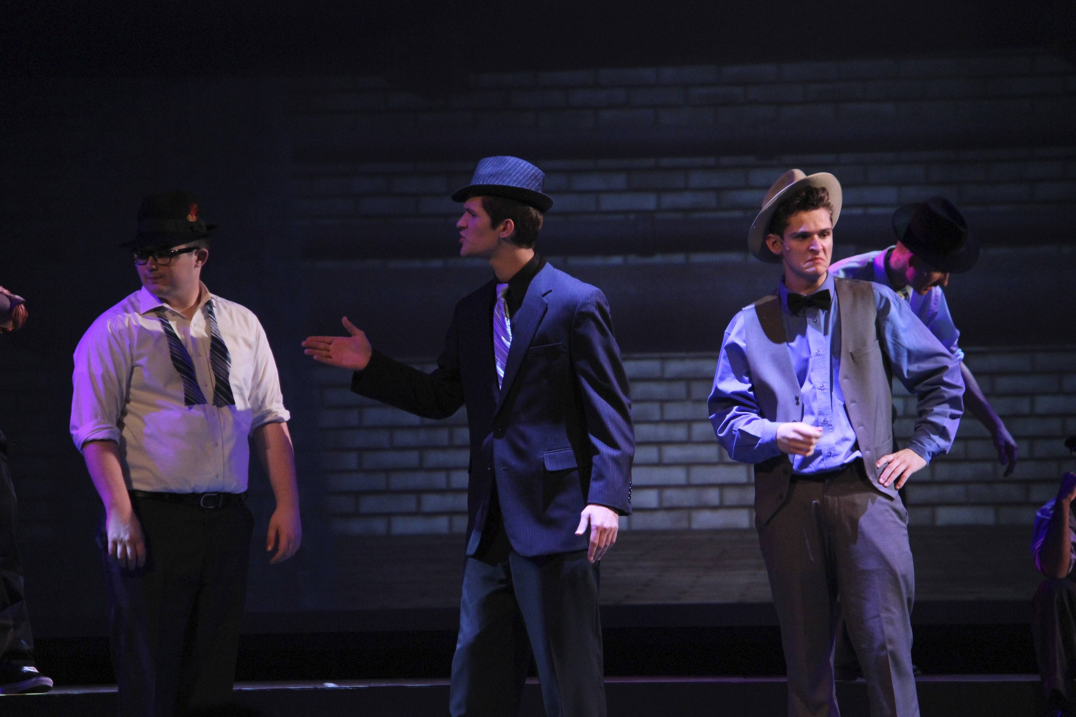 "Senior John Thornton, left, junior David Blaha and senior Jack Stover rehearse for Marmion Academy's production of ""Guys and Dolls."""
