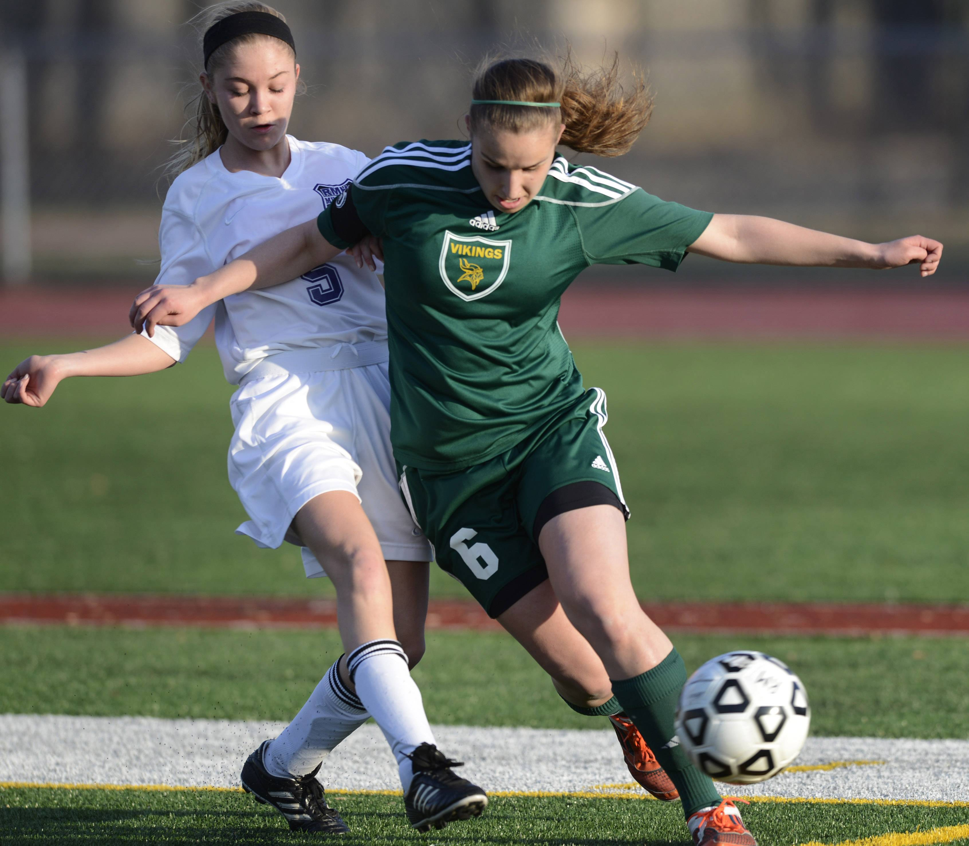 Fremd's Karolina Cholewa, right, gets between the ball and Rolling Meadows' Laura Kallal during Wednesday's game at Rolling Meadows.