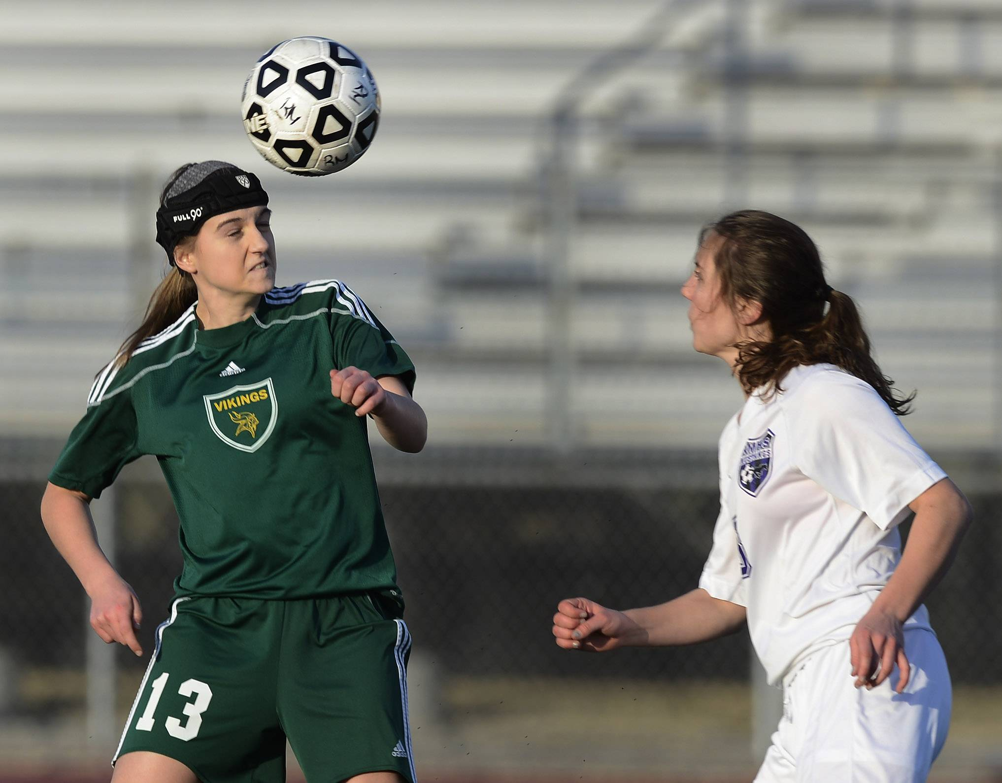 Fremd's Liz Flavin, left, tries to direct the ball past Rolling Meadows' Mary Collins during Wednesday's game at Rolling Meadows.