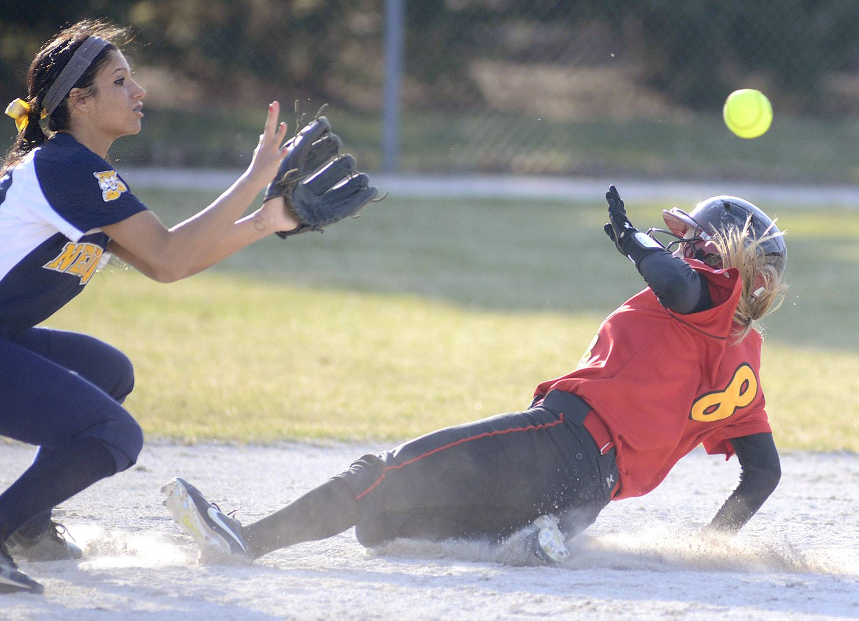 Batavia's Toni Galas slides safely into second base ahead of the throw to Neuqua Valley's Jamie O'Brien in the fifth inning on Wednesday in Batavia.
