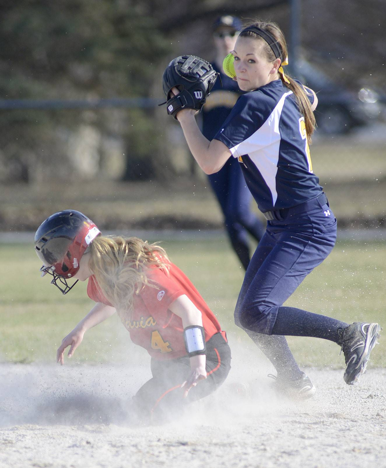Batavia's Elyse Burns is out at second base by Neuqua Valley's Julia Huebner in the first inning on Wednesday, April 9.