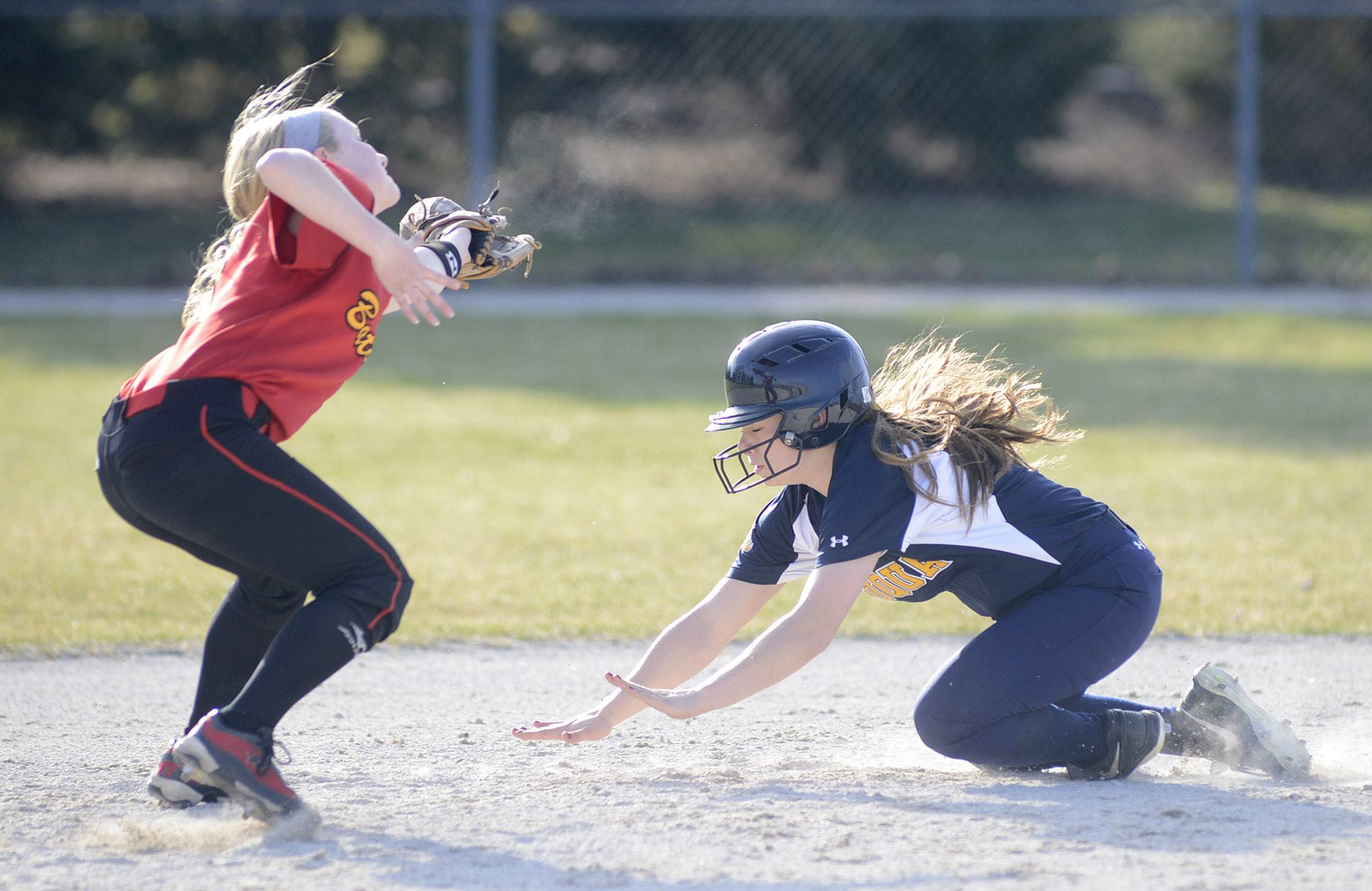 Neuqua Valley's Jenny Budds preps to safely slide into second base past Batavia's Elyse Burns in the fourth inning on Wednesday, April 9.