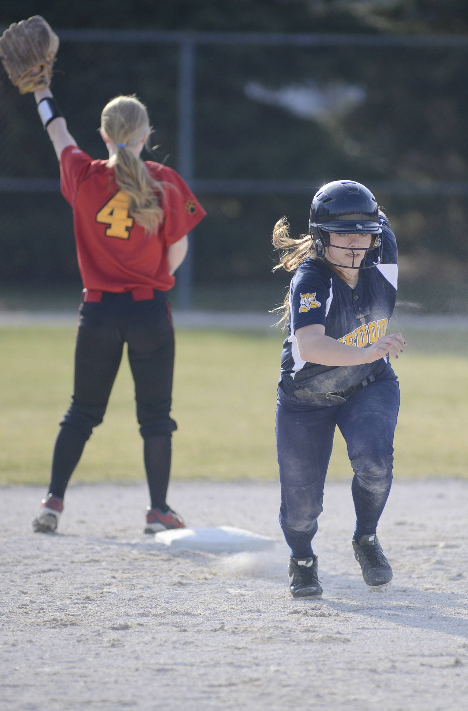 Neuqua Valley's Jenny Budds bolts to third base leaving Batavia's Elyse Burns behind at second base in the fourth inning on Wednesday, April 9.