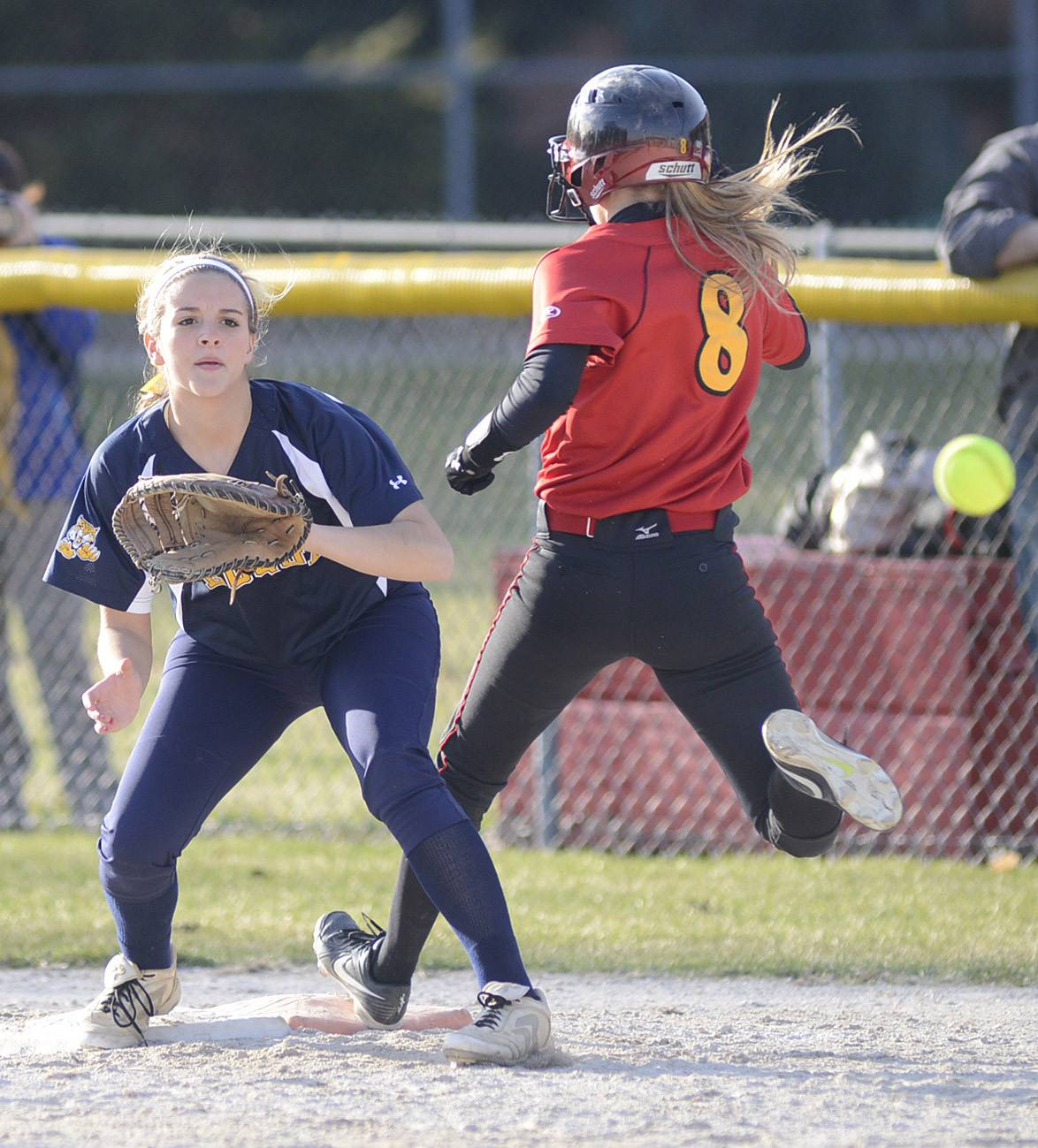Batavia's Toni Galas is safe on first before the ball hits the mitt of Neuqua Valley's Jessie Boudreau in the fifth inning on Wednesday, April 9.