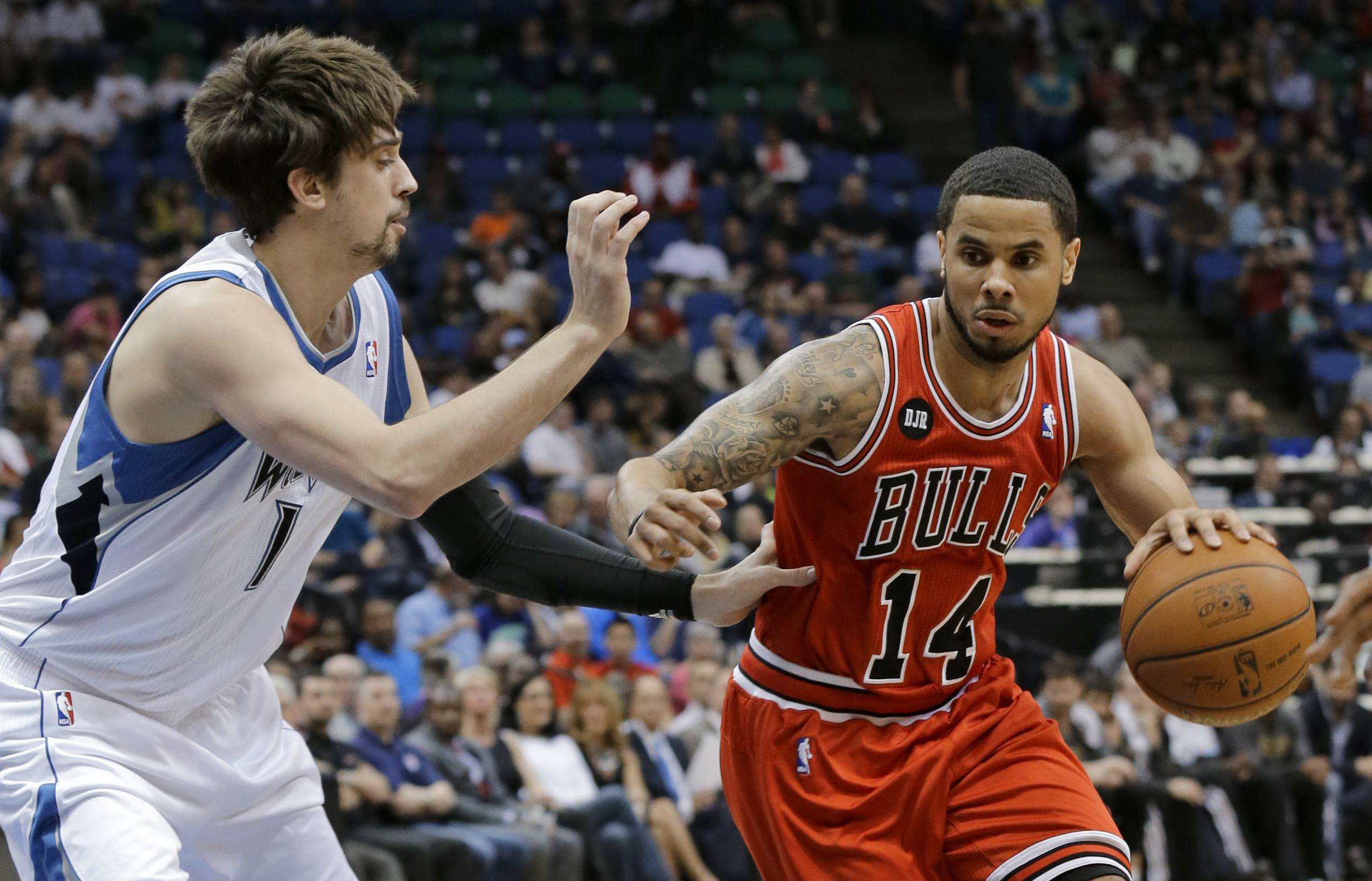 Chicago Bulls guard D.J. Augustin (14) drives against Minnesota Timberwolves guard Alexey Shved, left, of Russia, during the second quarter of an NBA basketball game in Minneapolis, Wednesday, April 9, 2014.