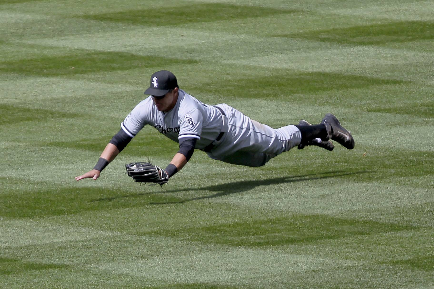 Chicago White Sox Avisail Garcia (26) makes a diving catch on a drive to right by Colorado Rockies DJ LeMahieu during the fourth inning of a baseball game, Wednesday, April 9, 2014, in Denver.