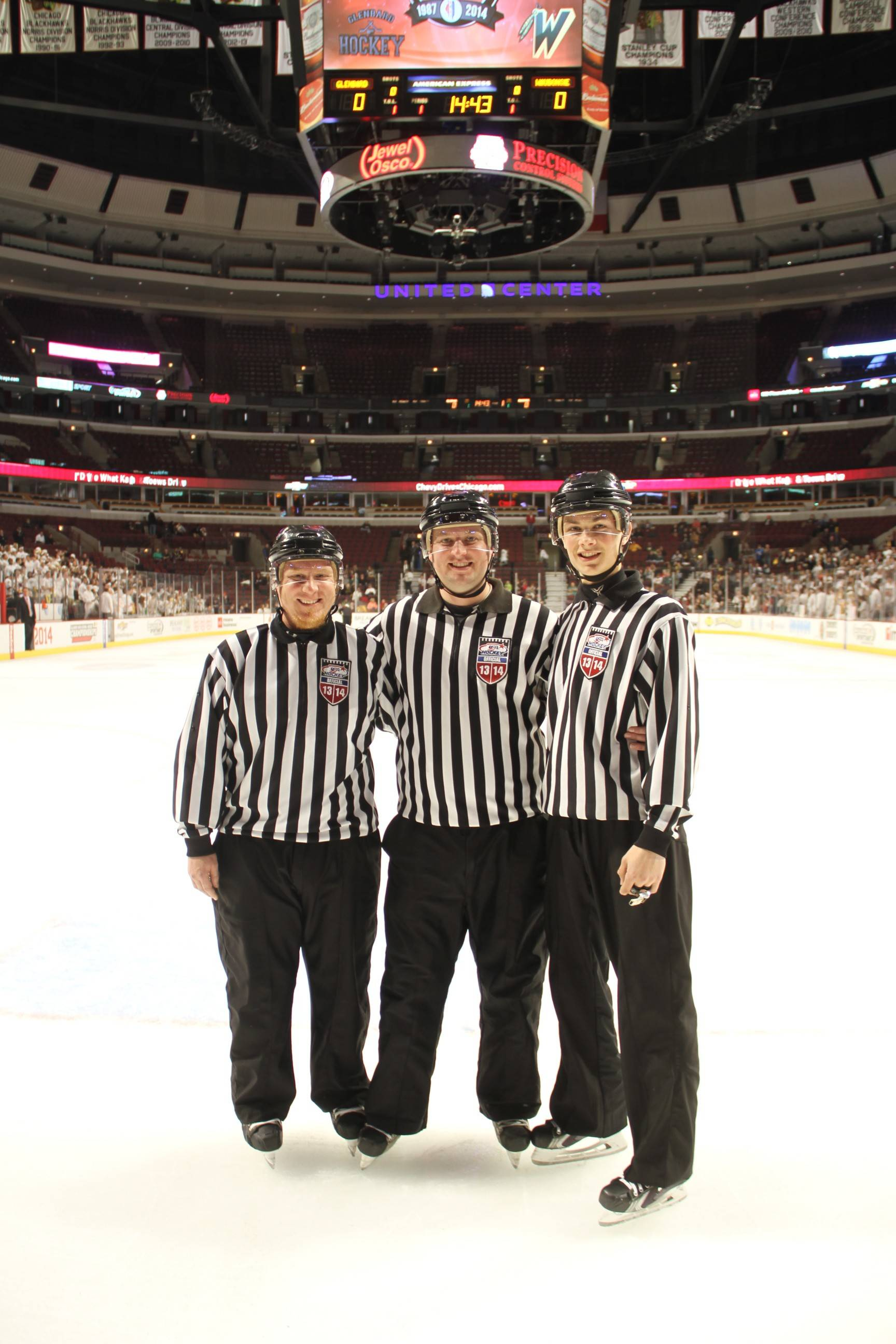 From left, TJ Torba, Brad Baumruck and Shane Gustafson, on the ice at the United Center to work the Combined Division championship game.