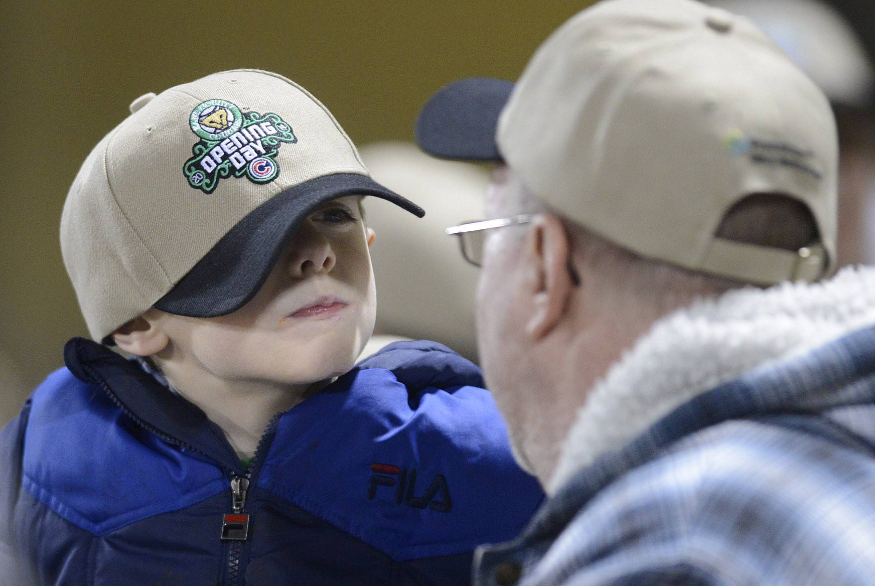 "Conner Chambers, 7, of Geneva makes a face at his grandfather, Tom Concannon, also of Geneva, as they react after missing their opportunity to appear on the ""Smile Cam""."