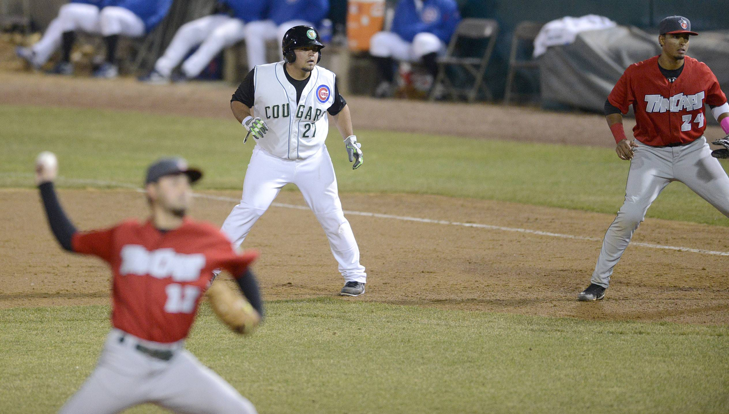 Kane County Cougars' Danny Canela leads off first base in the sixth inning .
