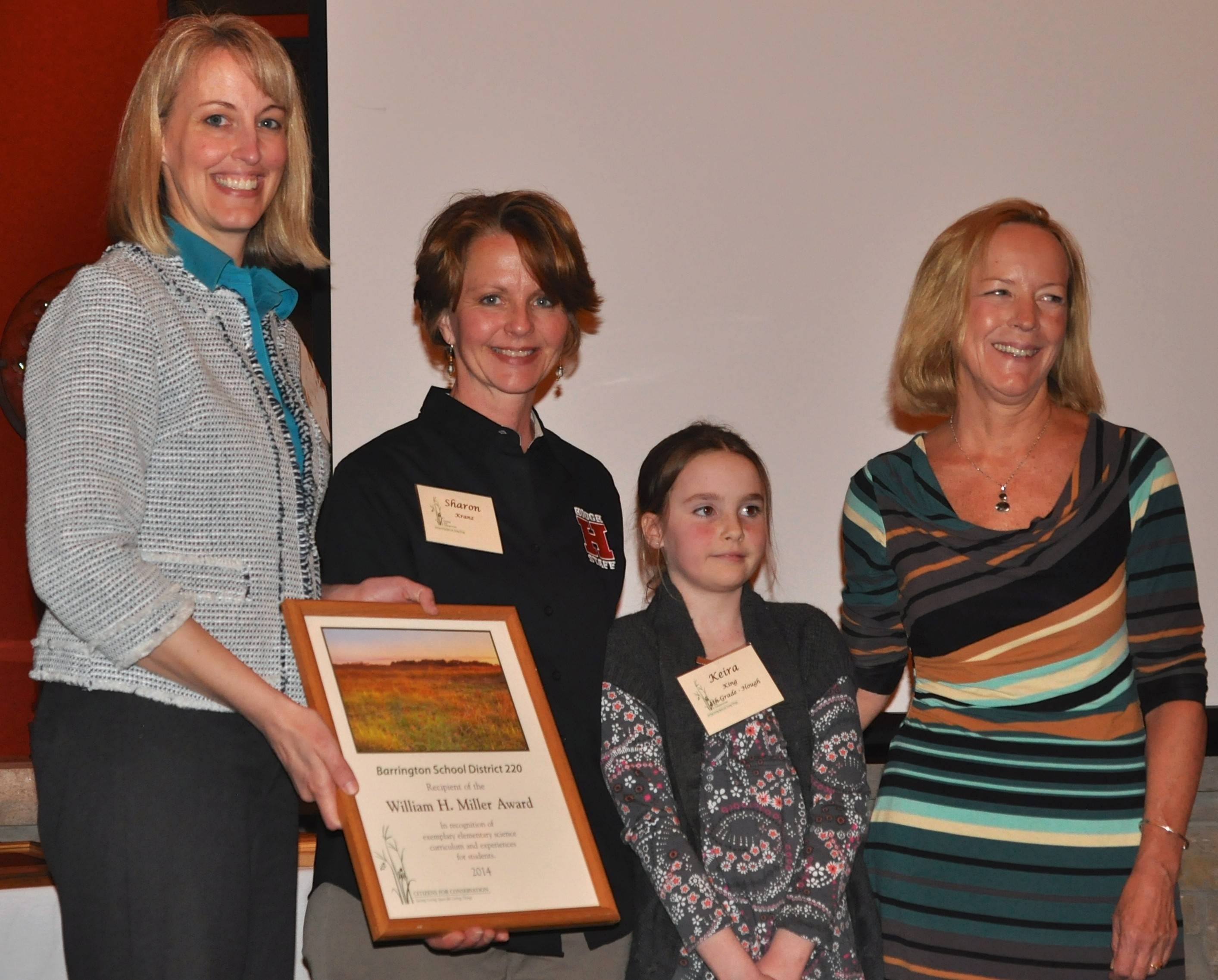 Representatives of Barrington 220 accept Citizens for Conservation's highest award, The William H. Miller Conservation Award in recognition of outstanding conservation efforts within the Barrington area. Pictured, from left, are: Dr. Becky Gill-Schultz, District 220 director of elementary curriculum; Sharon Kranz, District 220 instructional coach; Keira King, fourth grade student at Hough Street School; and Dr. Anne Grall-Reichel, the educational researcher who helped develop the program.