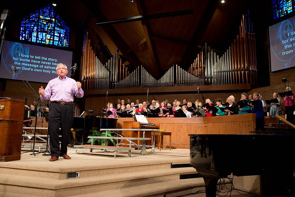 Hymn Sing host, Stan Guillaume, conducts the choir and audience at October's Hymn Sing.Greg Heck