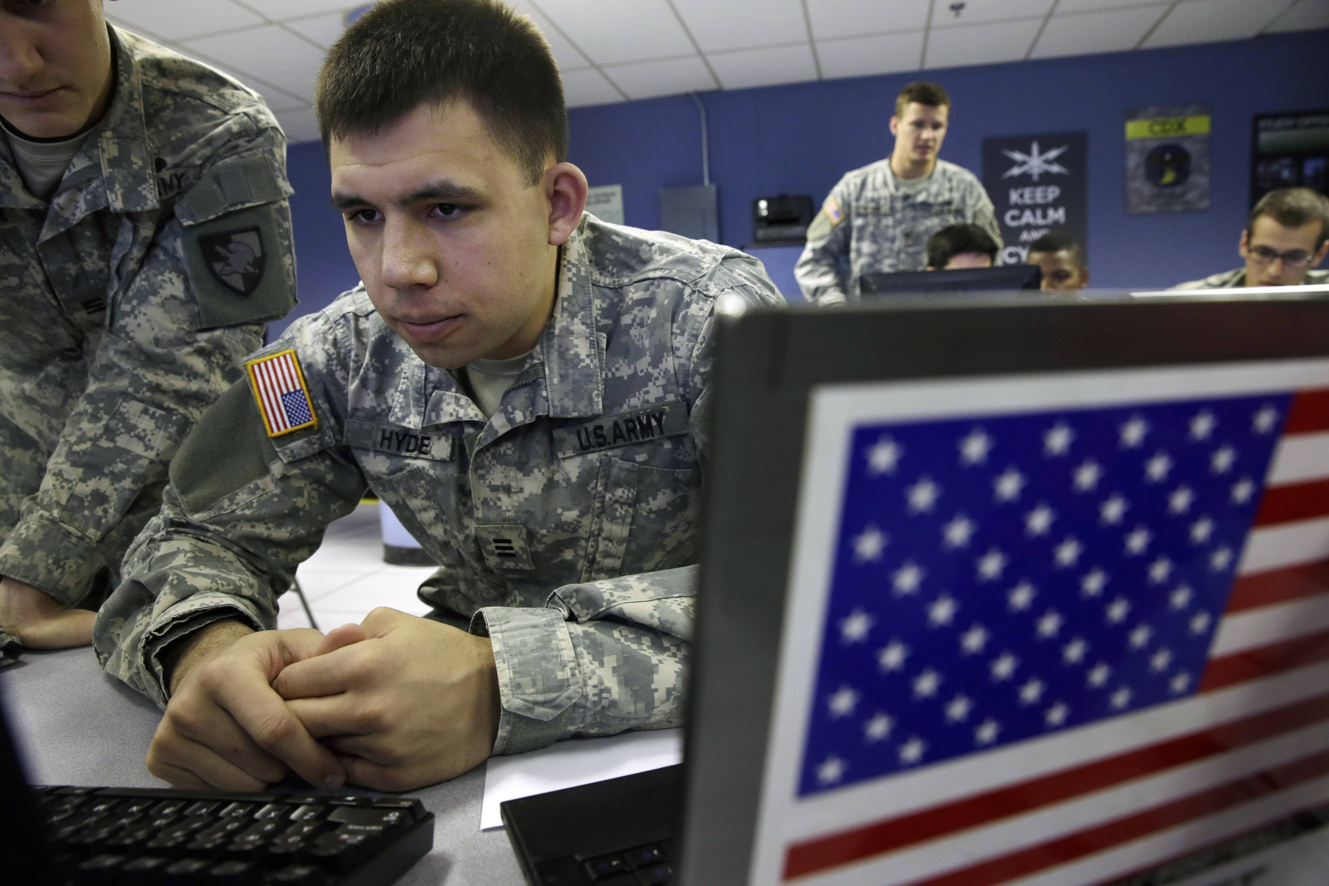 United States Military Academy cadet Dylan Hyde watches data on a computer at the Cyber Research Center at the United States Military Academy in West Point, N.Y.