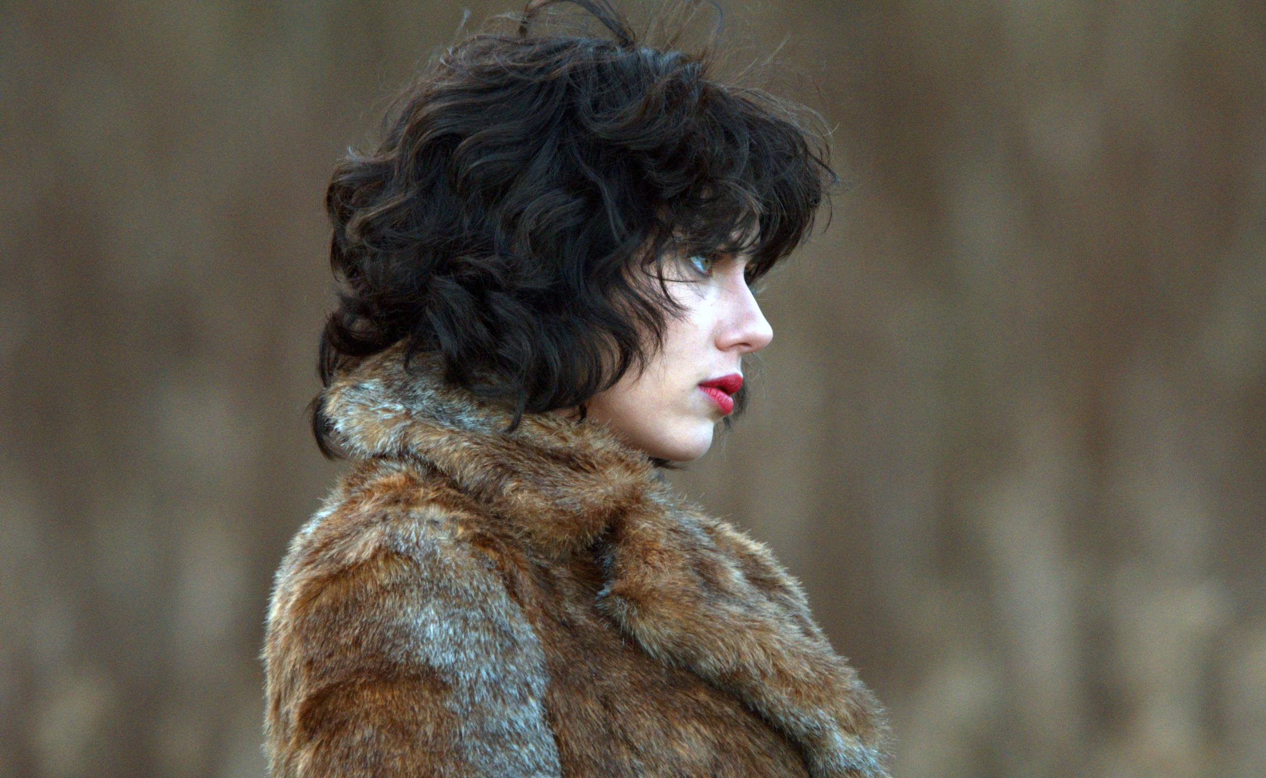 "An alien (Scarlett Johansson) preys on men in ""Under the Skin."""