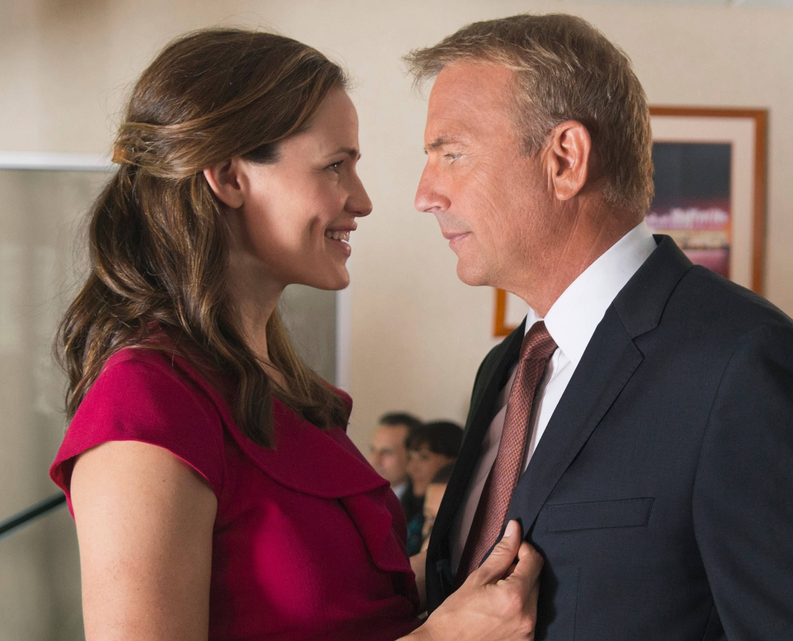"Ali (Jennifer Garner) scores with Cleveland Browns general manager Sonny Weaver (Kevin Costner) in the NFL drama ""Draft Day."""