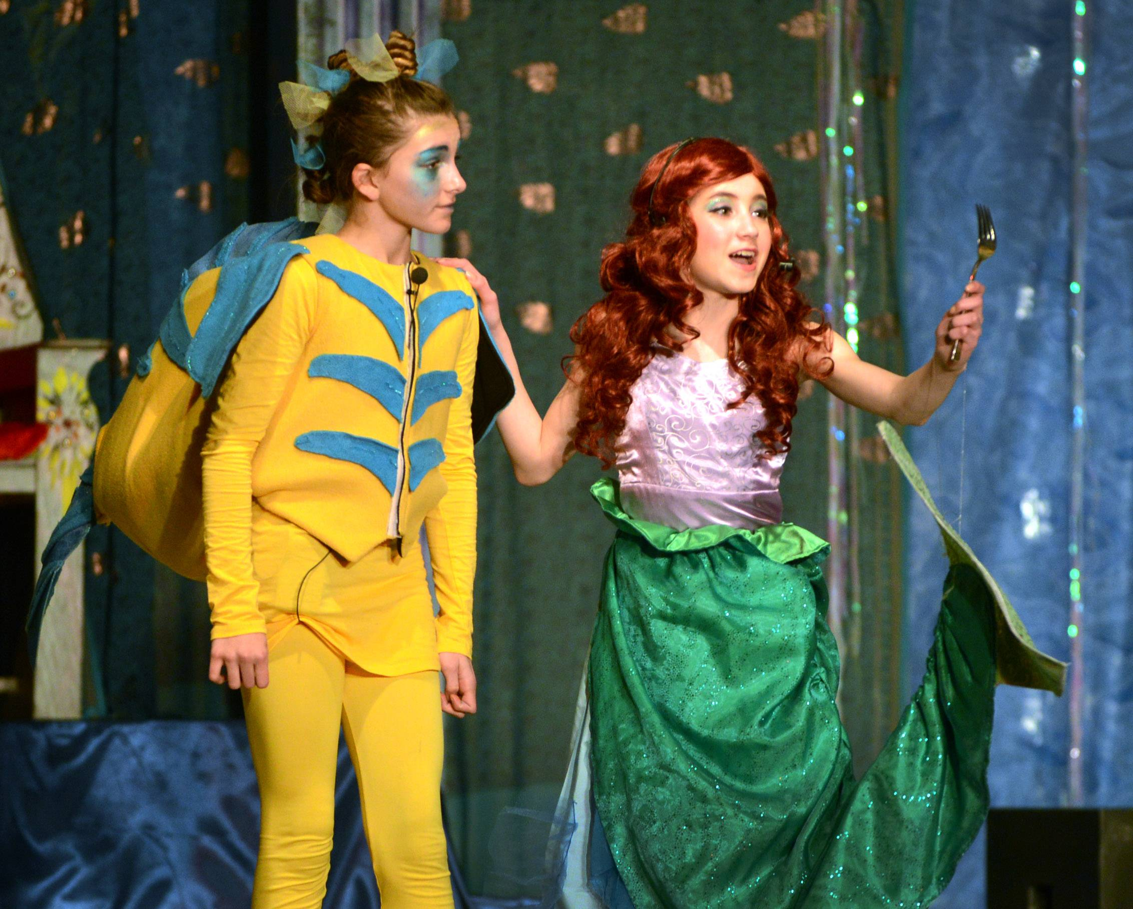 "Daniel Wright Junior High School students perform ""The Little Mermaid, Jr."" for second-graders Thursday in Lincolnshire. Hope Adler, left, plays Flounder, and Frankie Walsh plays Ariel."