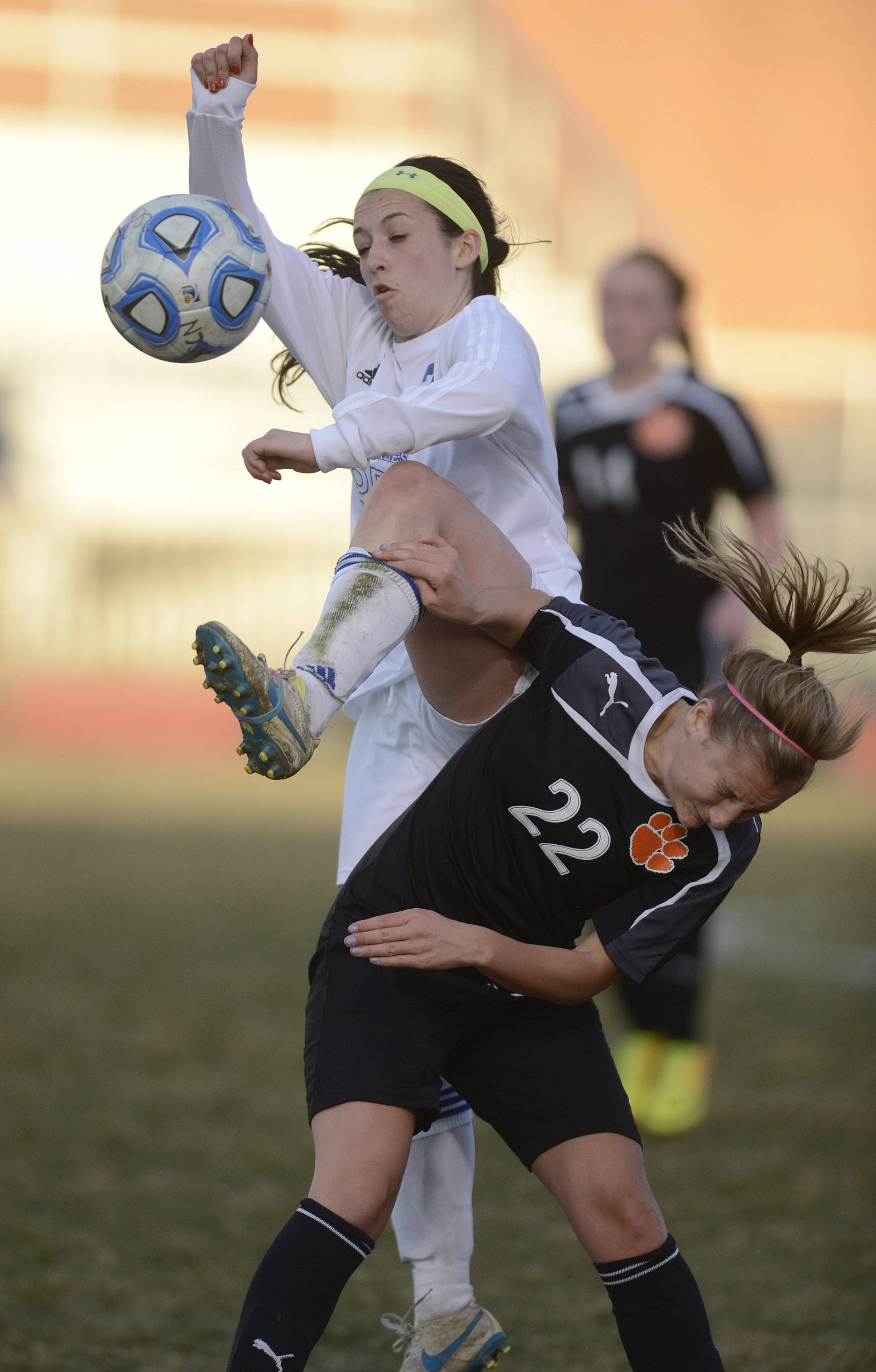 St. Charles North's Ashlyn Walter collides with Wheaton Warrenville South's Nikki Molino in the first half on Thursday during the North Stars' 1-0 win in St. Charles.