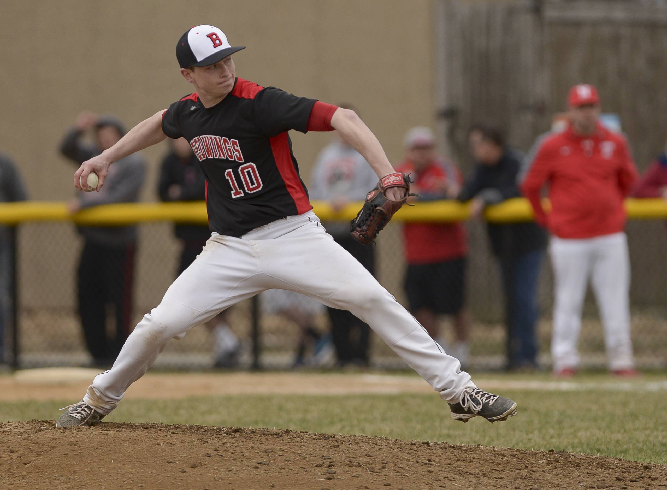 Benet Academy's Pat Peterson pitches during the Redwings 2-1 win over Naperville Central Thursday in Naperville.