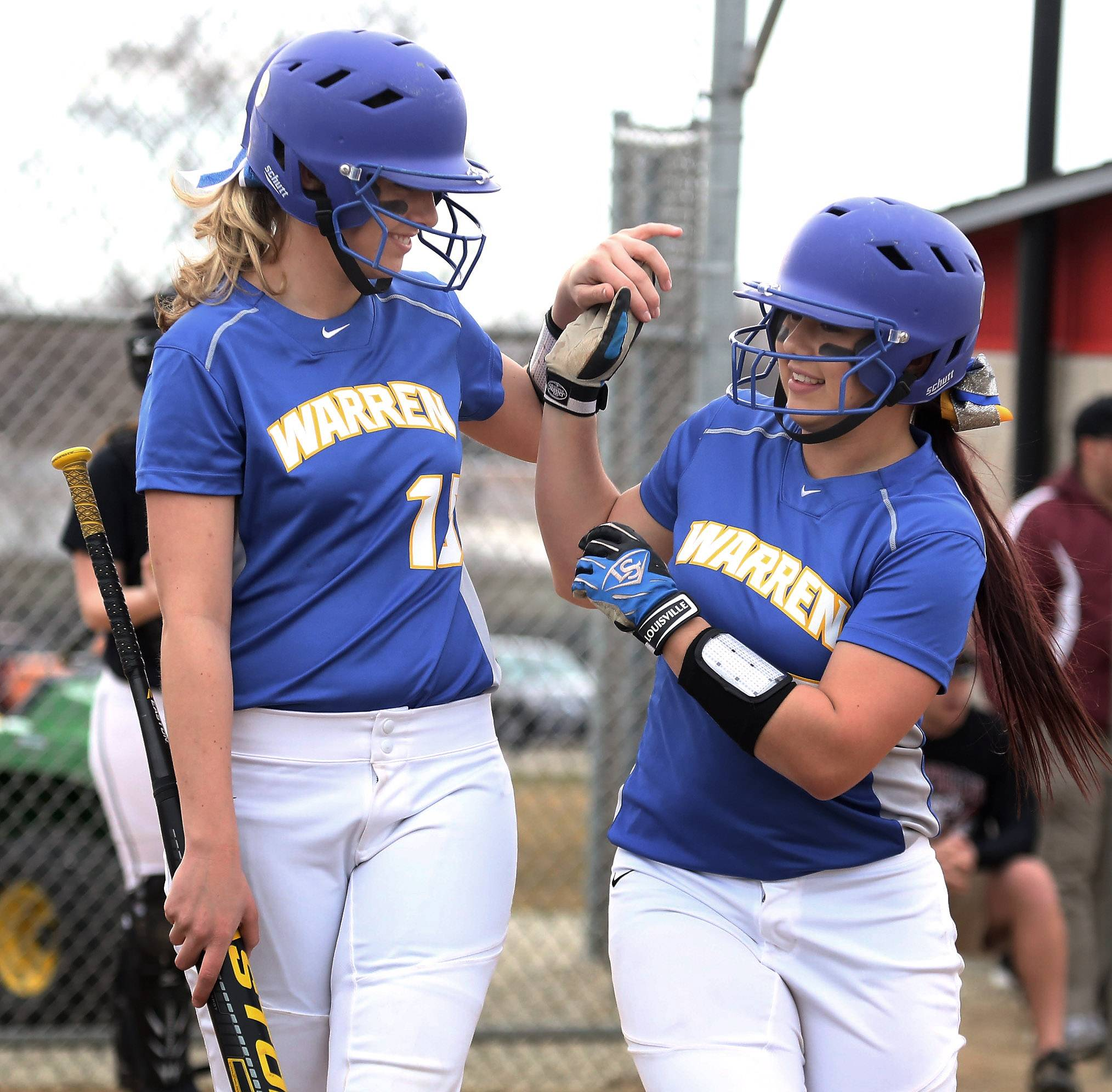Warren's Jodie Hurd, left congratulates teammate Megan Scott after she hit a home run in the second inning against host Antioch on Thursday.