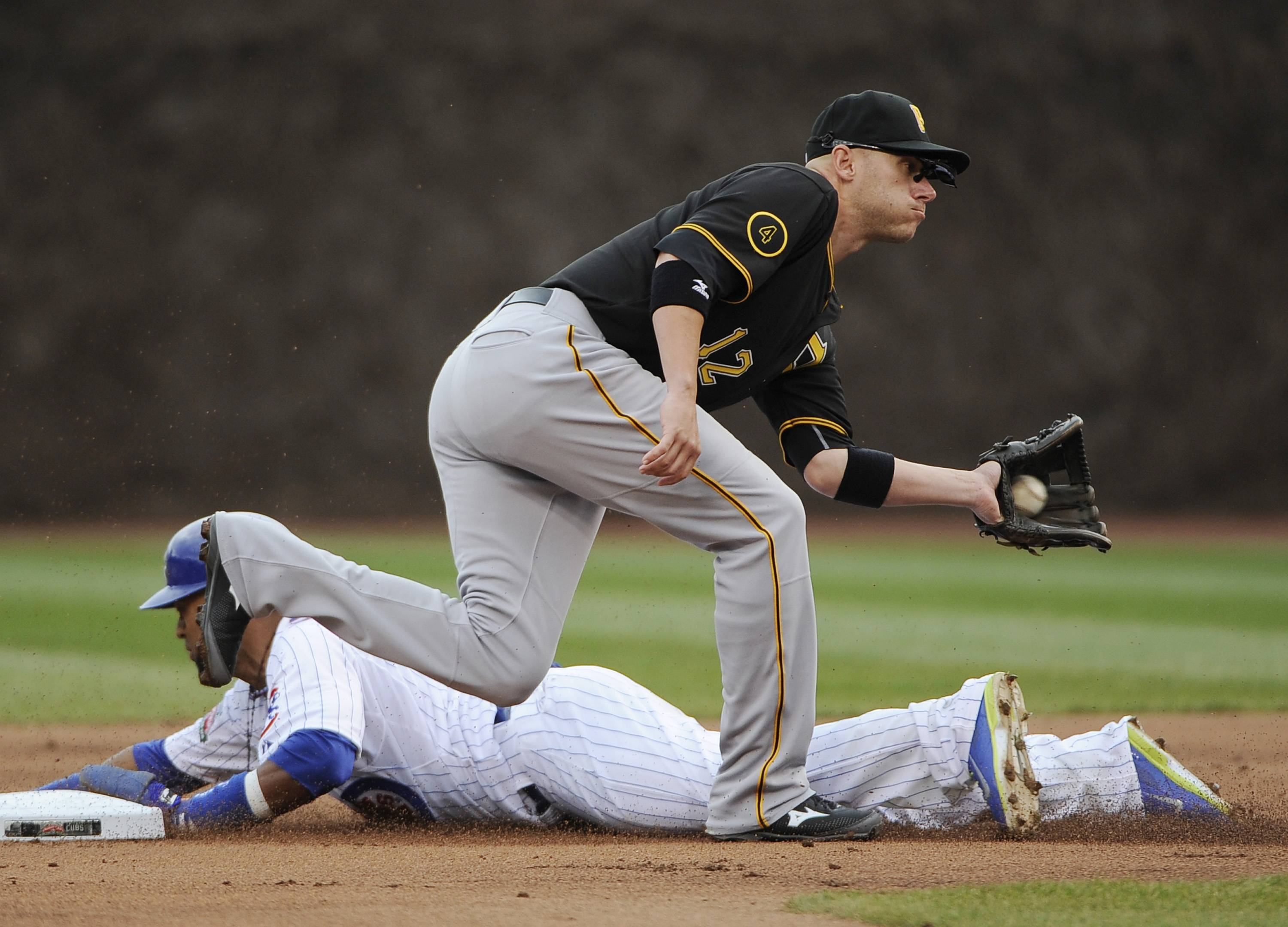 Emilio Bonifacio steals second base as Pittsburgh Pirates shortstop Clint Barmes (12) takes the throw during the first inning of a baseball game, Thursday, April 10, 2014 in Chicago.