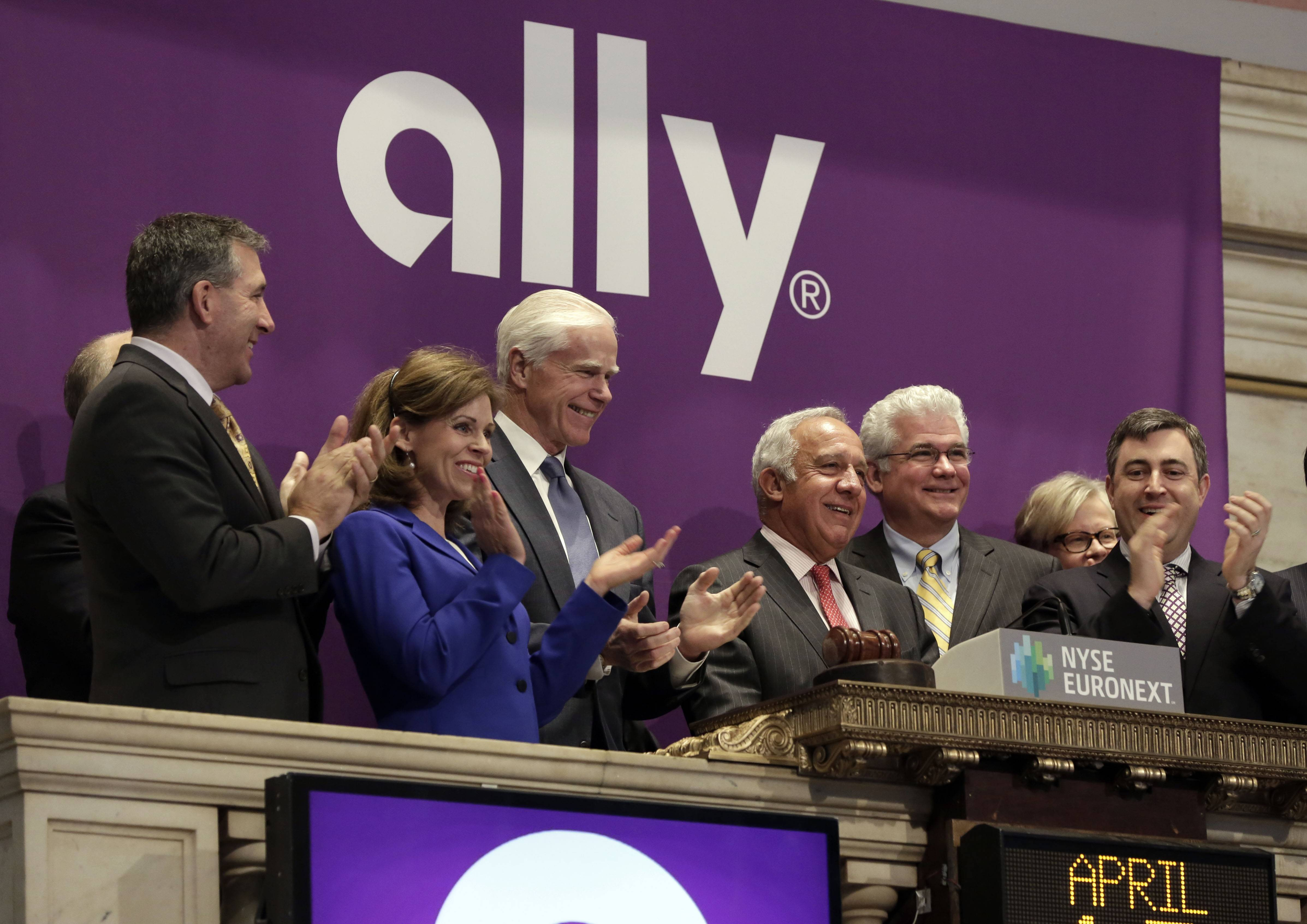 Ally Financial CEO Michael Carpenter, third from right, is applauded as he rings the New York Stock Exchange opening bell Thursday to mark his company's IPO. The Treasury Department has raised $2.38 billion after selling a large chunk of its stock in Ally Financial Inc. as part of the government's ongoing effort to recoup the billions of dollars spent bailing out companies during the 2008 financial crisis.