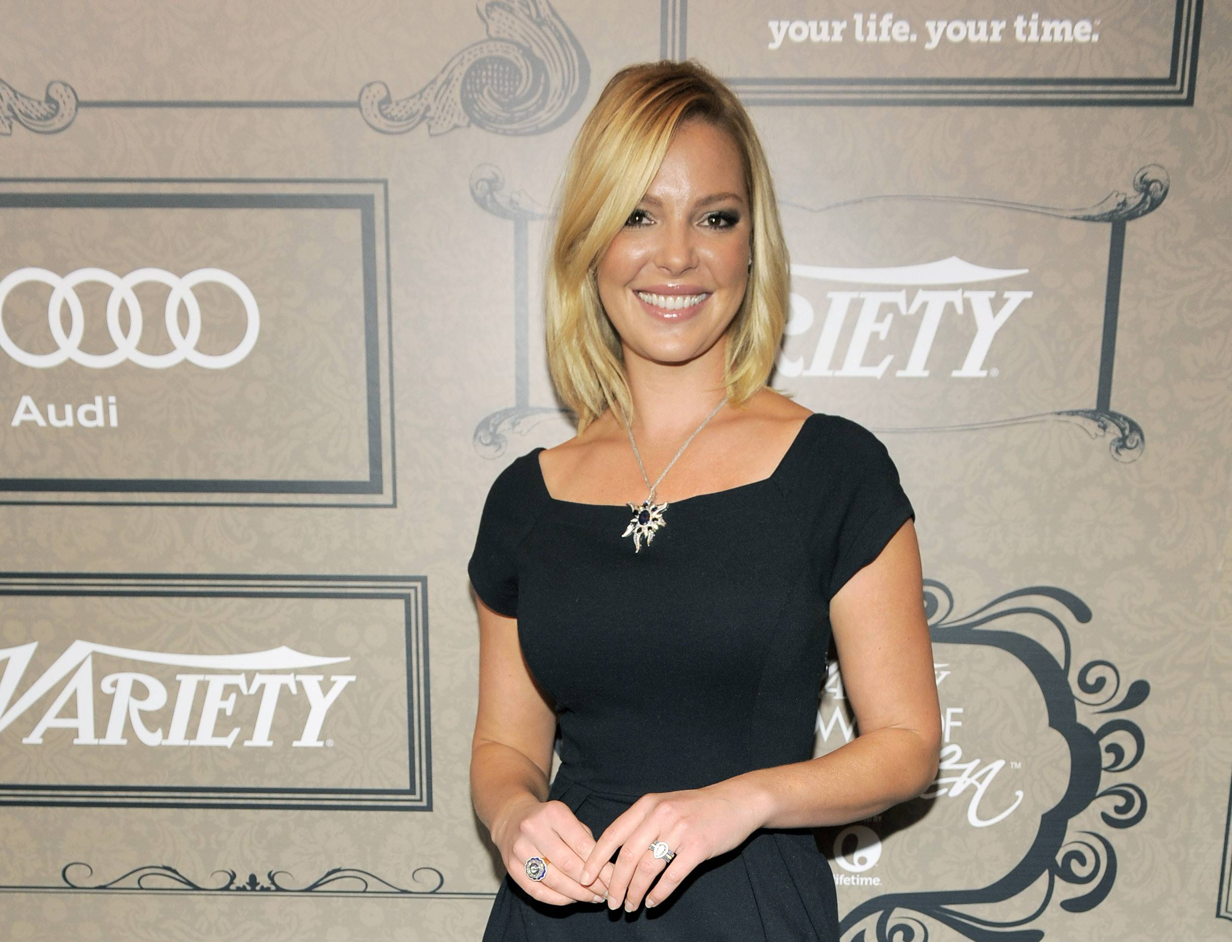 Actress Katherine Heigl has sued Duane Reade Inc., saying the company is using a picture of her leaving one of its pharmacies in its promotional materials.