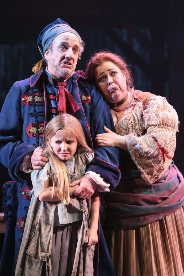 "The Thenardiers (Mark David Kaplan and Sharon Sachs) show mock remorse over the now-orphaned Cosette (Sage Harper) in ""Les Misérables"" at the Drury Lane Theatre in Oakbrook Terrace."