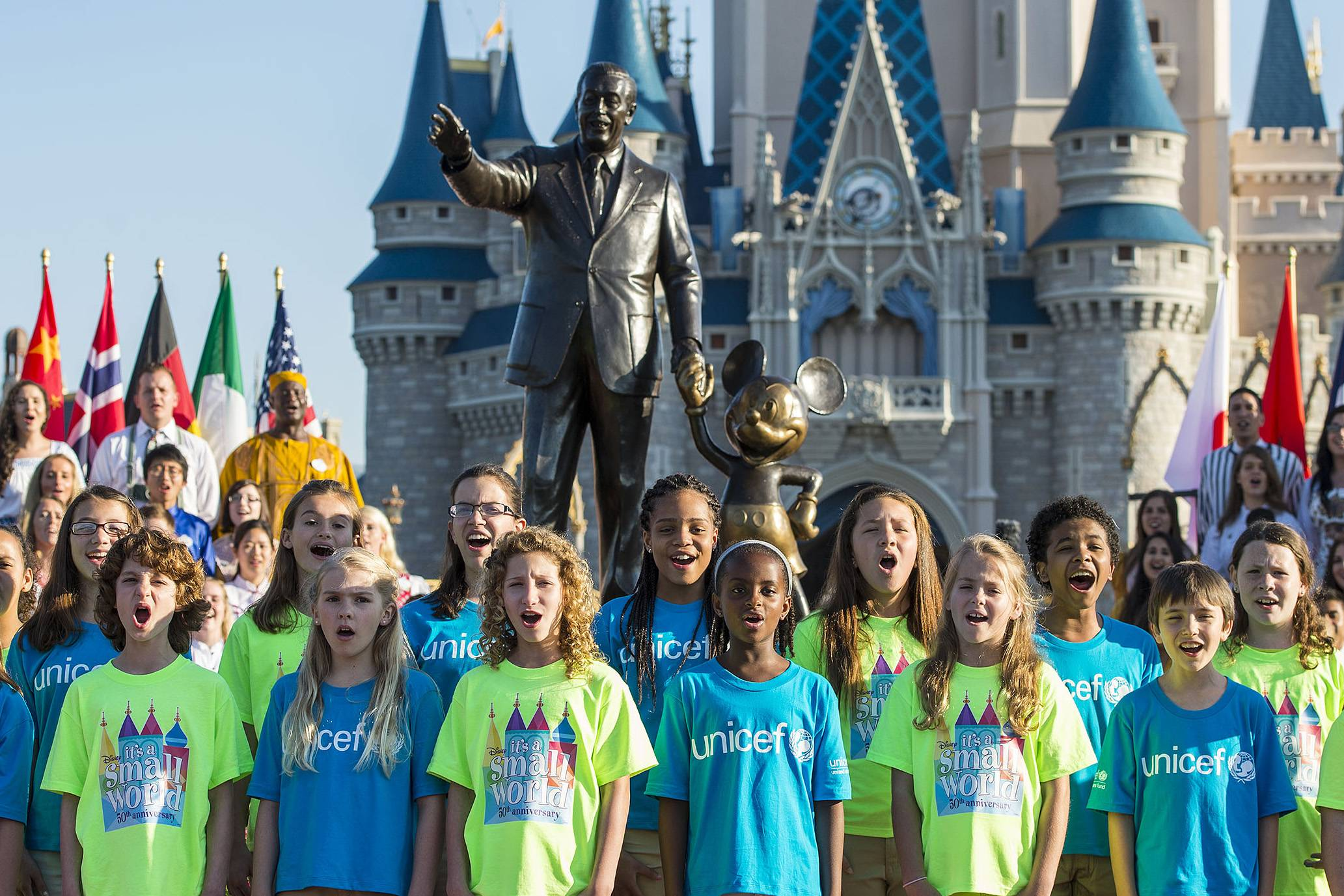 "A children's chorus sings ""It's a small world"" at the Magic Kingdom in Lake Buena Vista, Fla. The song turns 50 this year."