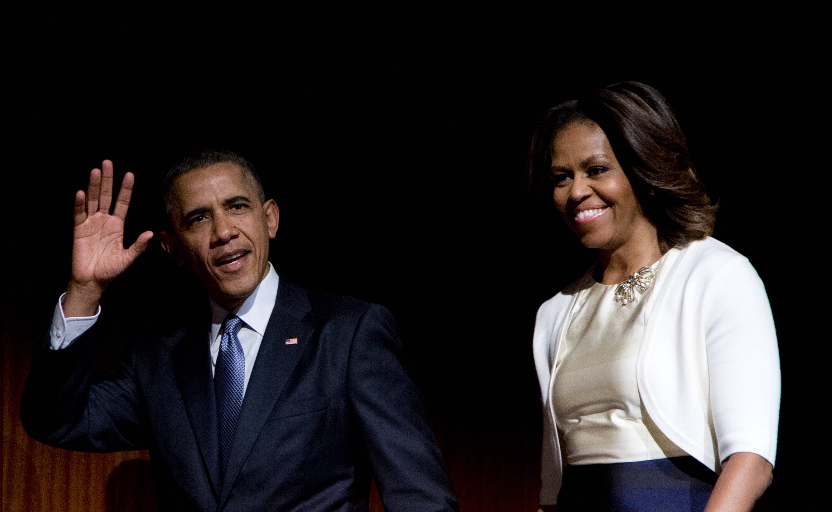 President Barack Obama and first lady Michelle Obama arrive on stage before the president spoke at the LBJ Presidential Library Thursday in Austin, Texas, during the Civil Rights Summit to commemorate the 50th anniversary of the signing of the Civil Rights Act.