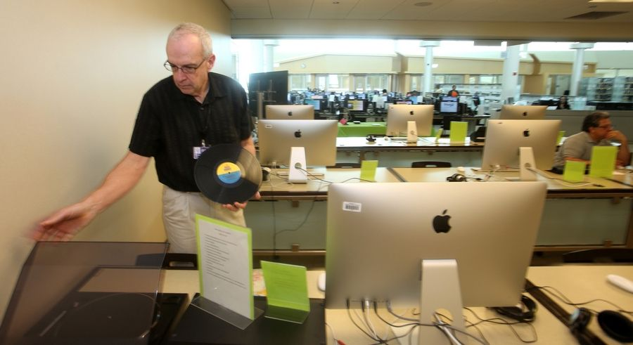 The new Idea Lab at the 95th Street Library in Naperville offers residents the ability to digitize old vinyl records. Help desk employees like Jeff Smallwood facilitate the process.