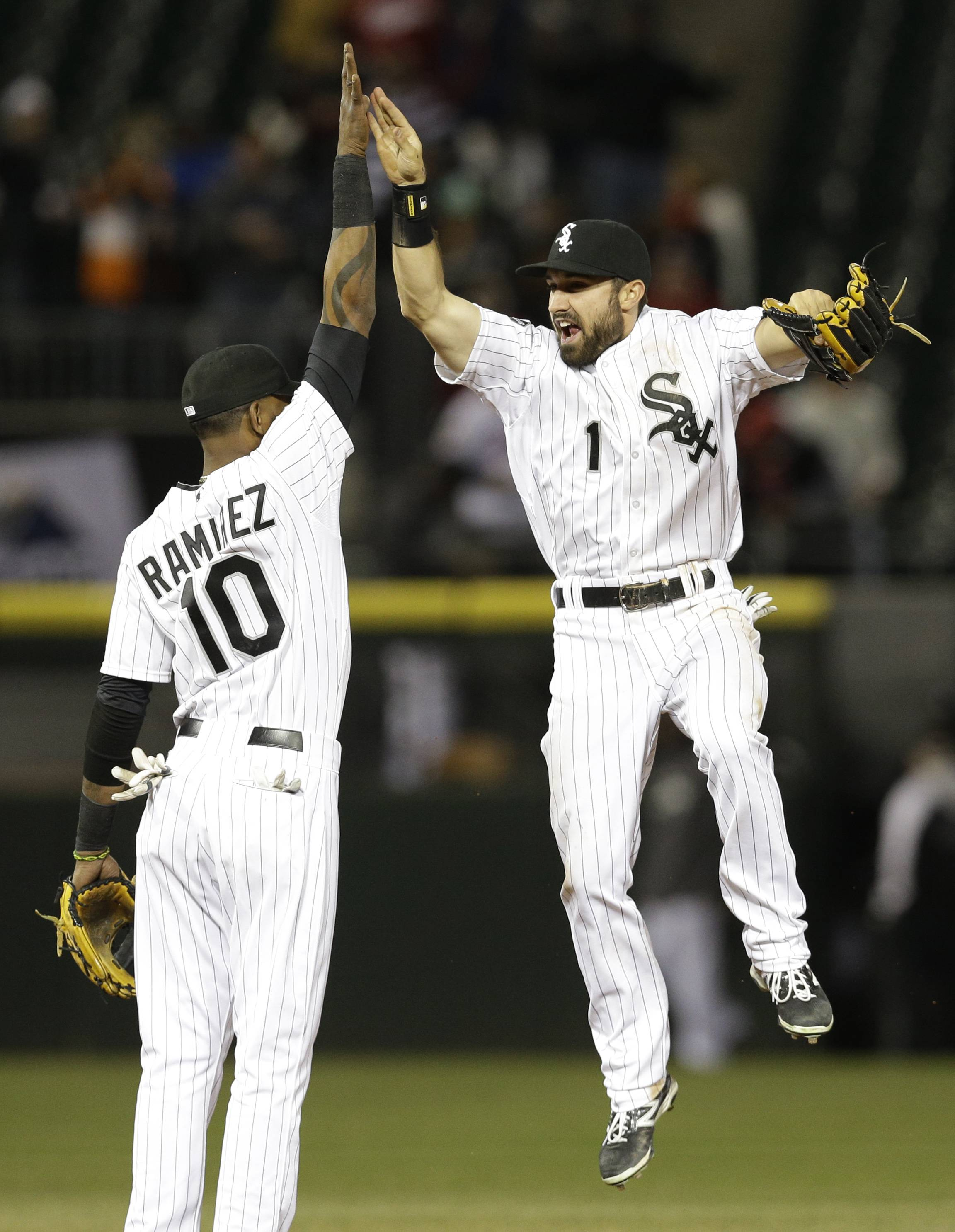 Adam Eaton, right, celebrates with Alexei Ramirez after they defeated the Cleveland Indians 7-3 in a baseball game in Chicago, Thursday, April 10, 2014.