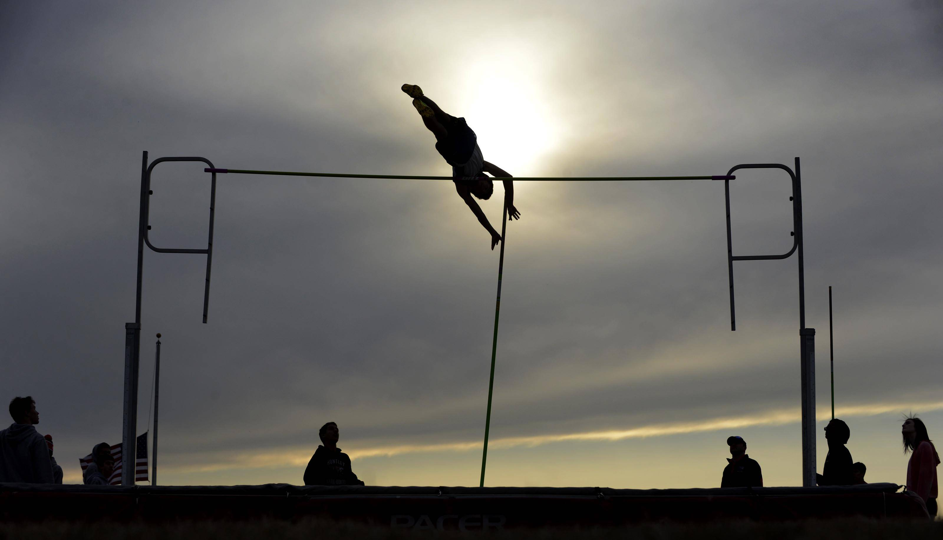 Burlington Central's Keegan Whitmer clears the bar in the pole vault Thursday at the Huntley boys track invitational.