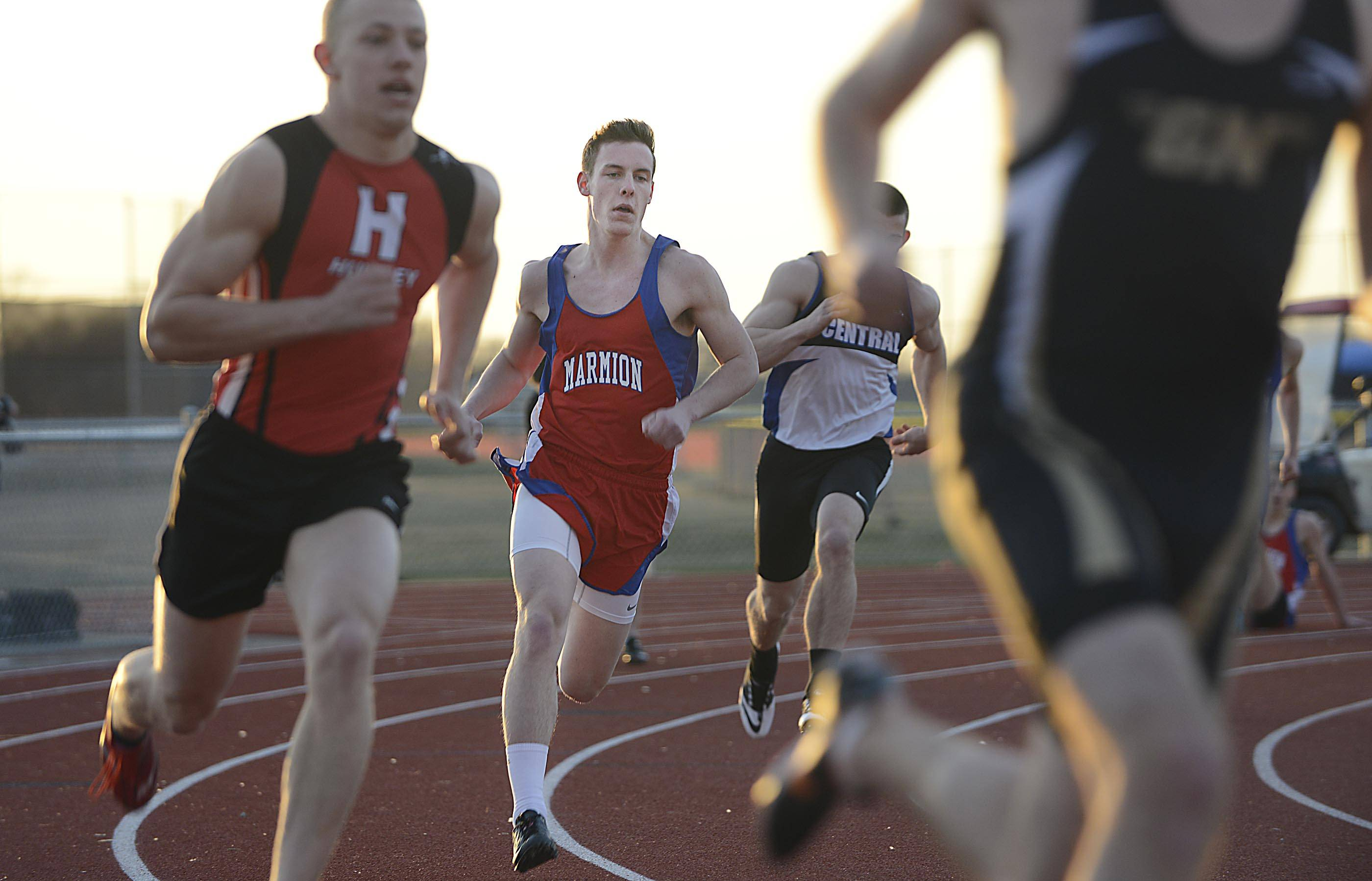 Marmion Academy's Andrew Grahovec rounds turn one in his heat of the 400-meter run Thursday at the Huntley boys track invitational.