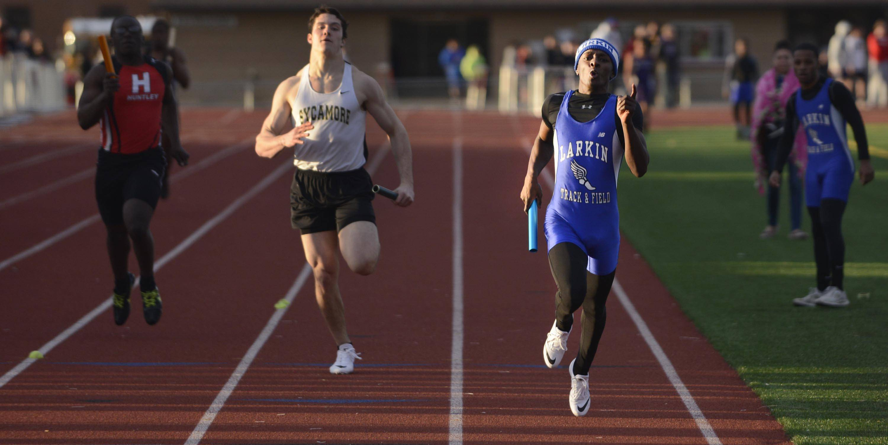 Larkin's Jarelle Shipp crosses the finish line in first place as the anchor leg of the Royals' 800-meter relay team Thursday at the Huntley boys track invitational.