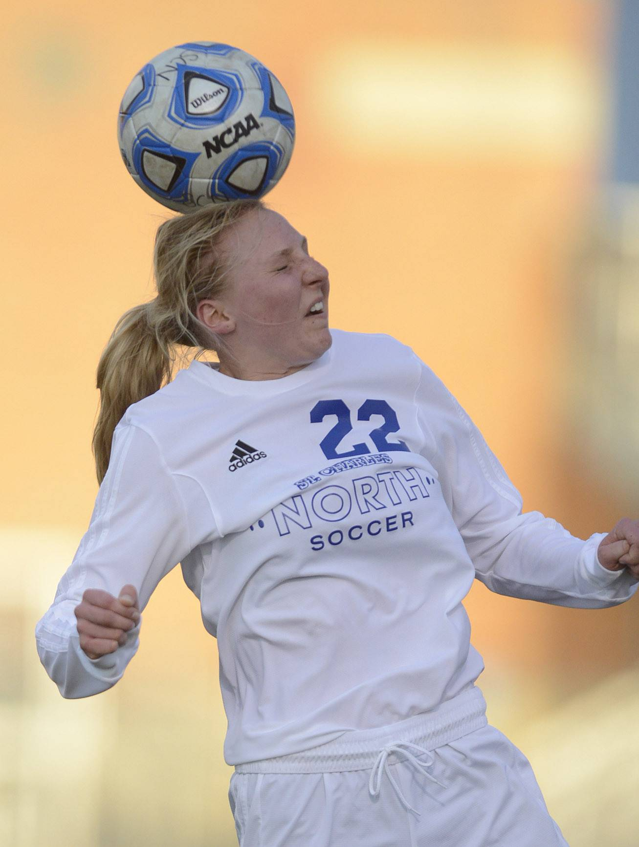 St. Charles North's Sophie Pohl heads the ball in the first half vs. Wheaton Warrenville South on Thursday, April 10.