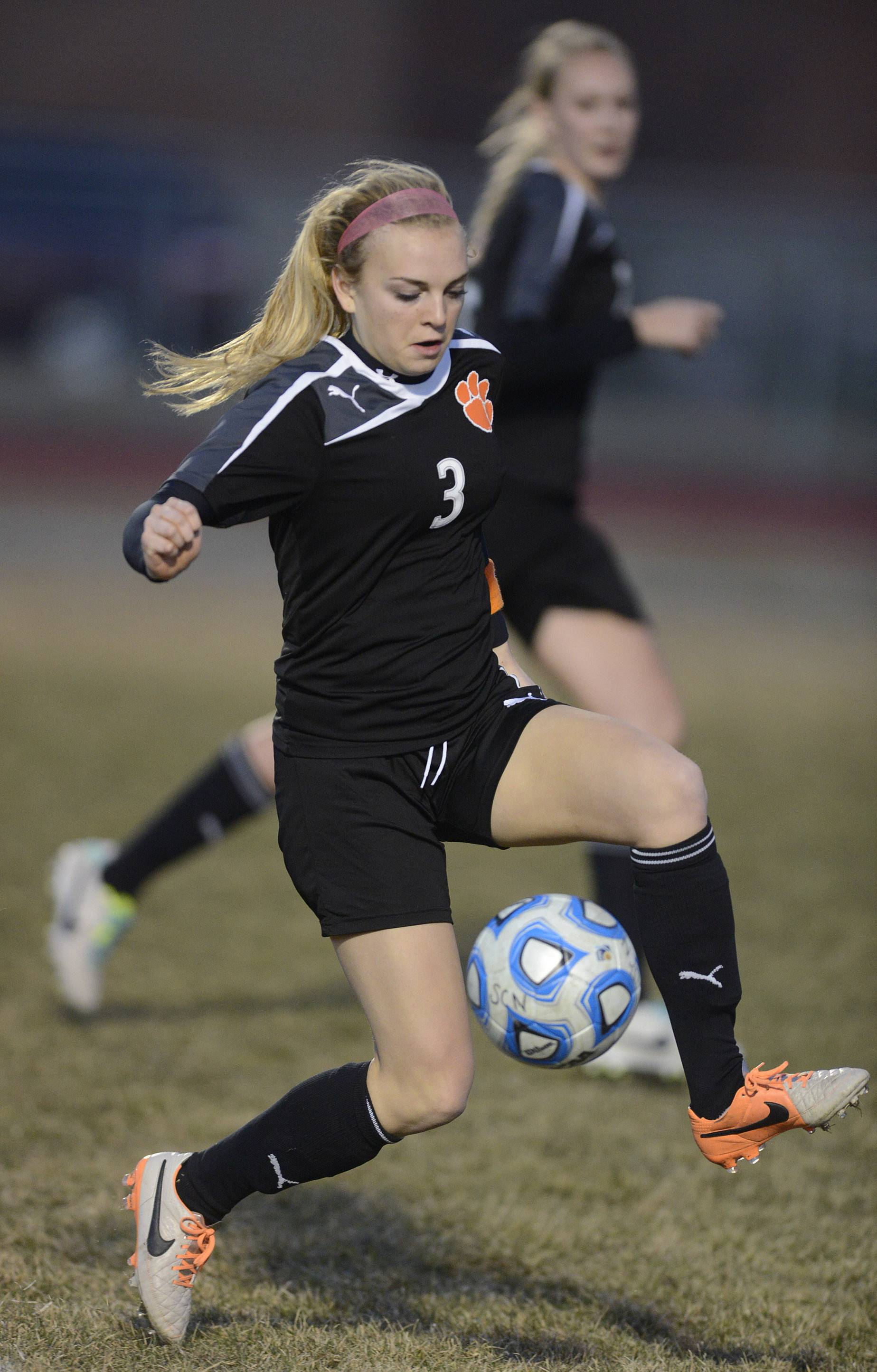 Wheaton Warrenville South's Ava Fickle vs. St. Charles North in the first half on Thursday, April 10.