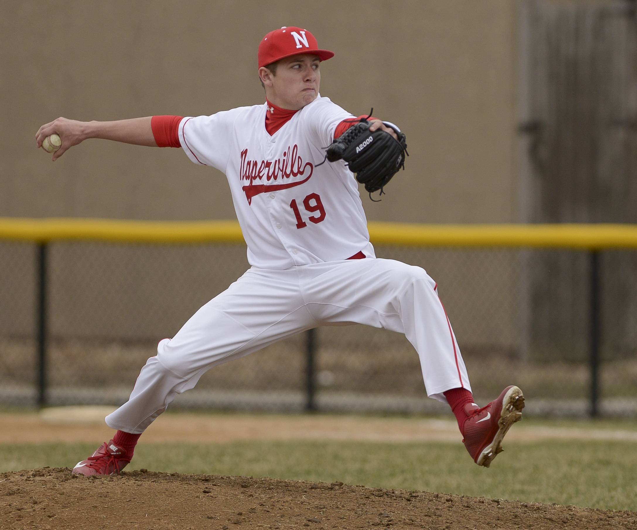 Naperville Central's Tony Perungaro  pitches during the his tems 2-1 loss to Benet Academy Thursday in at home.