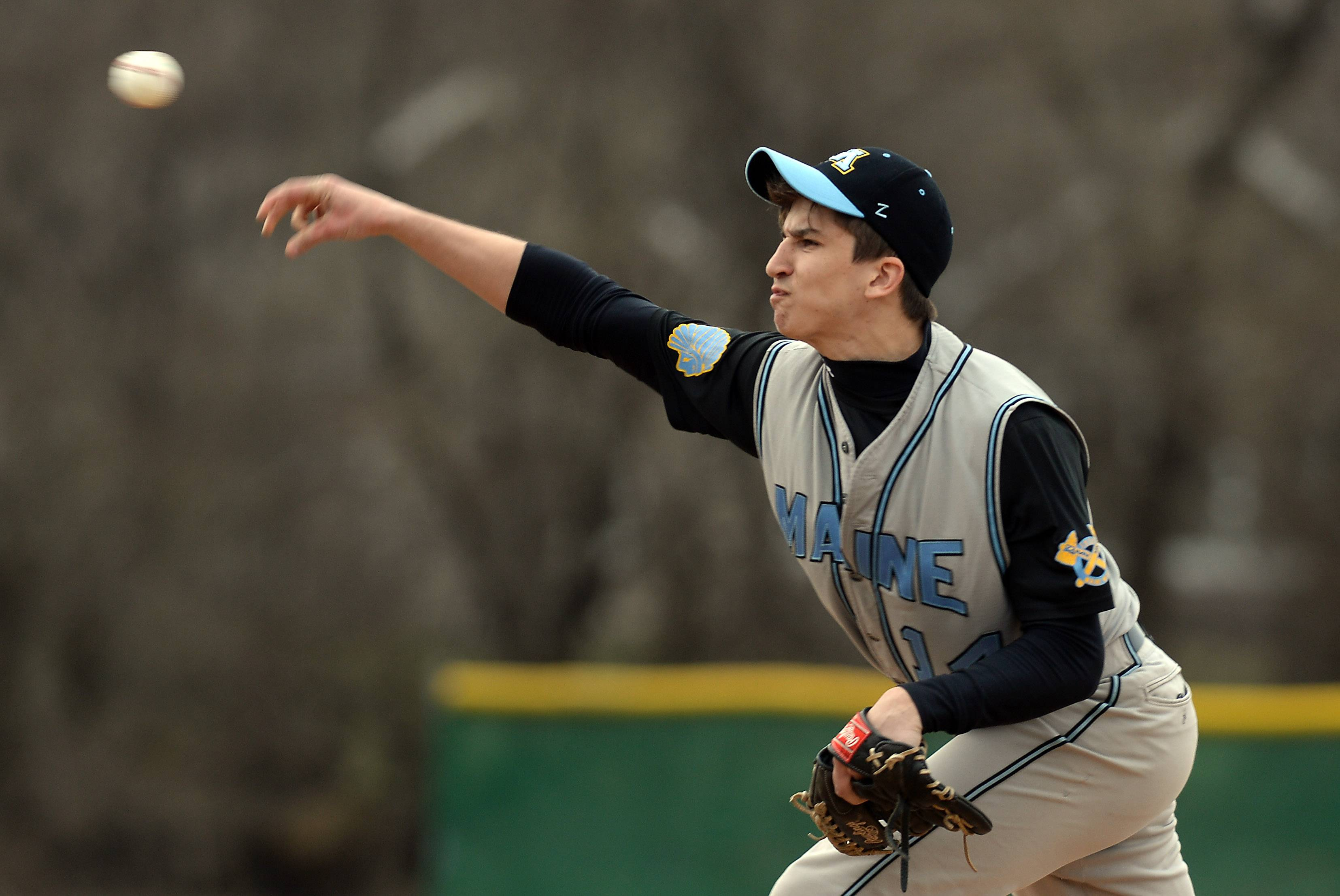 Maine West's Matt Swanson delivers to an Elk Grove hitter on Thursday at Elk Grove.
