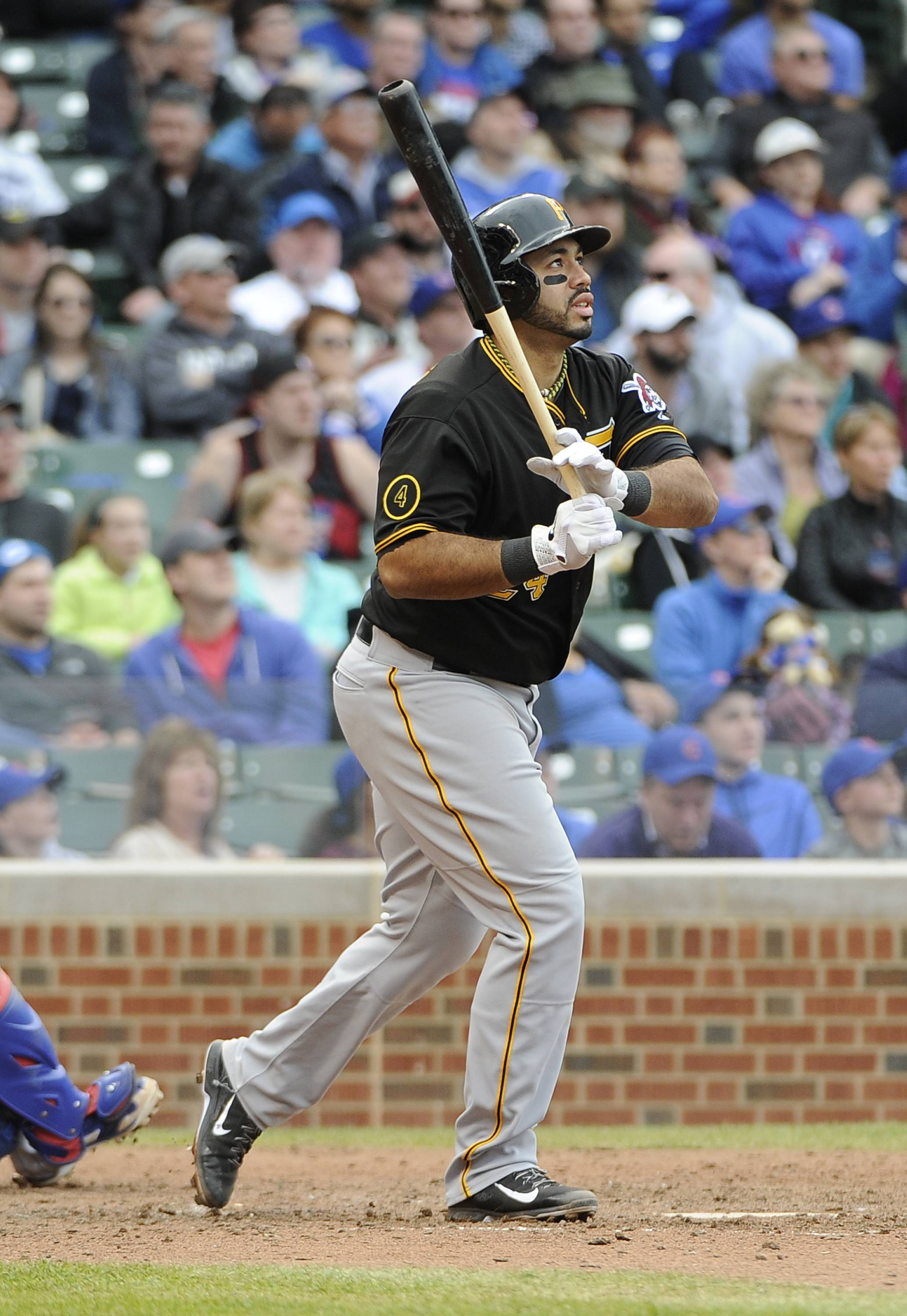 Pittsburgh Pirates' Pedro Alvarez watches his  three-run home run against the Chicago Cubs during the seventh inning of a baseball game on Thursday, April 10, 2014, in Chicago.