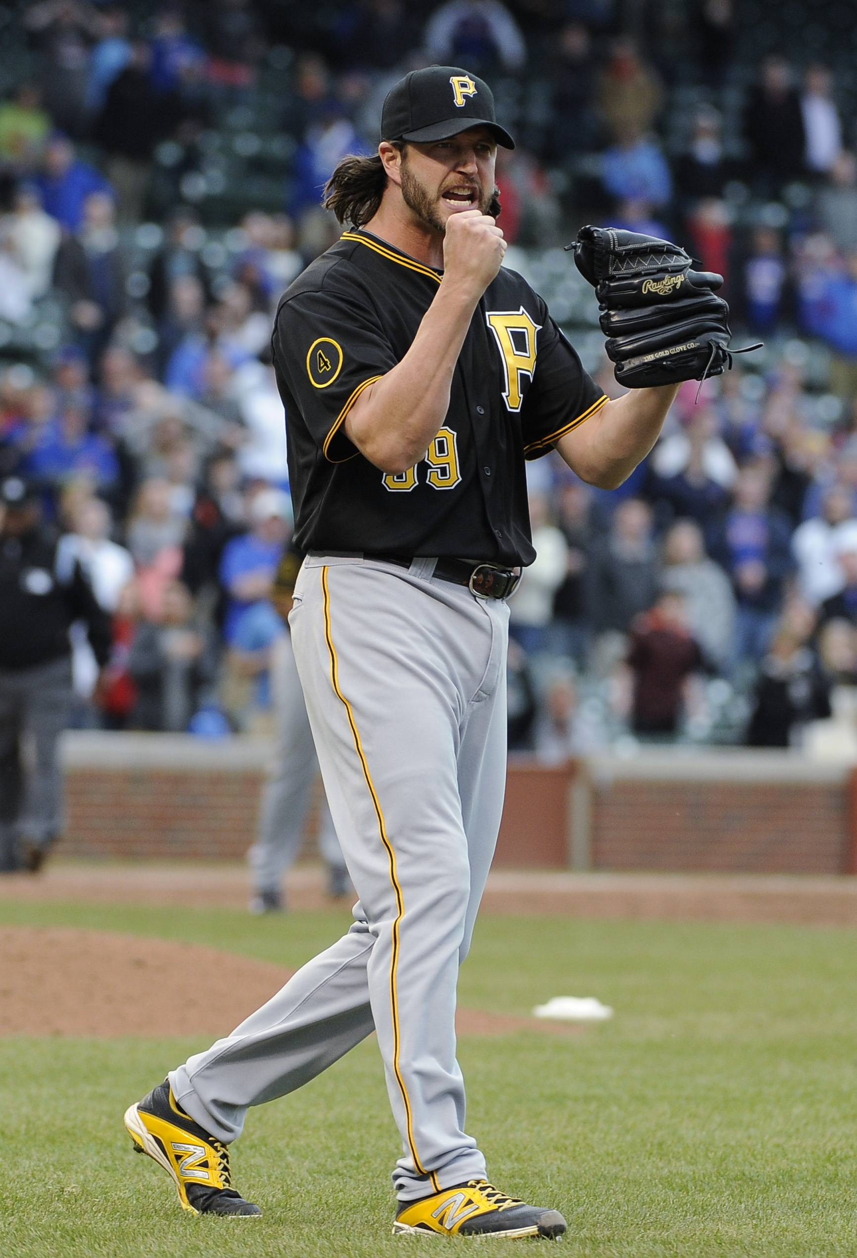 Pittsburgh Pirates relief pitcher Jason Grilli reacts after getting the last out against the Chicago Cubs in a baseball game, Thursday, April 10, 2014, in Chicago. The Pirates won 5-4.