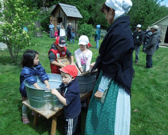 Children learn 19th century spring chores at Spring Valley.Photo by Ali Chinlund, SAPS