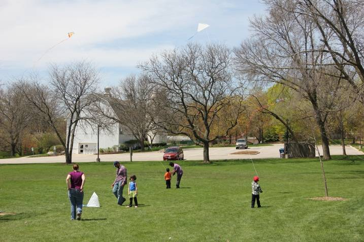 Families fly kites at Kite Fly and Family Picnic.Schaumburg Park District